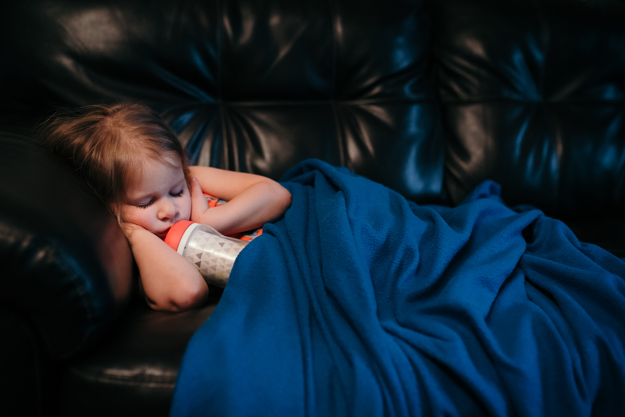girl asleep with sippy cup
