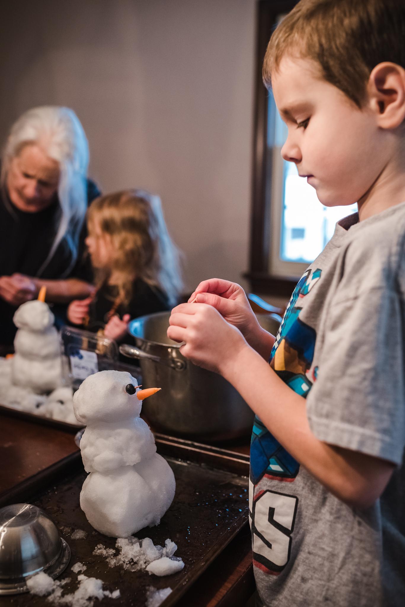 kids making snowmen inside
