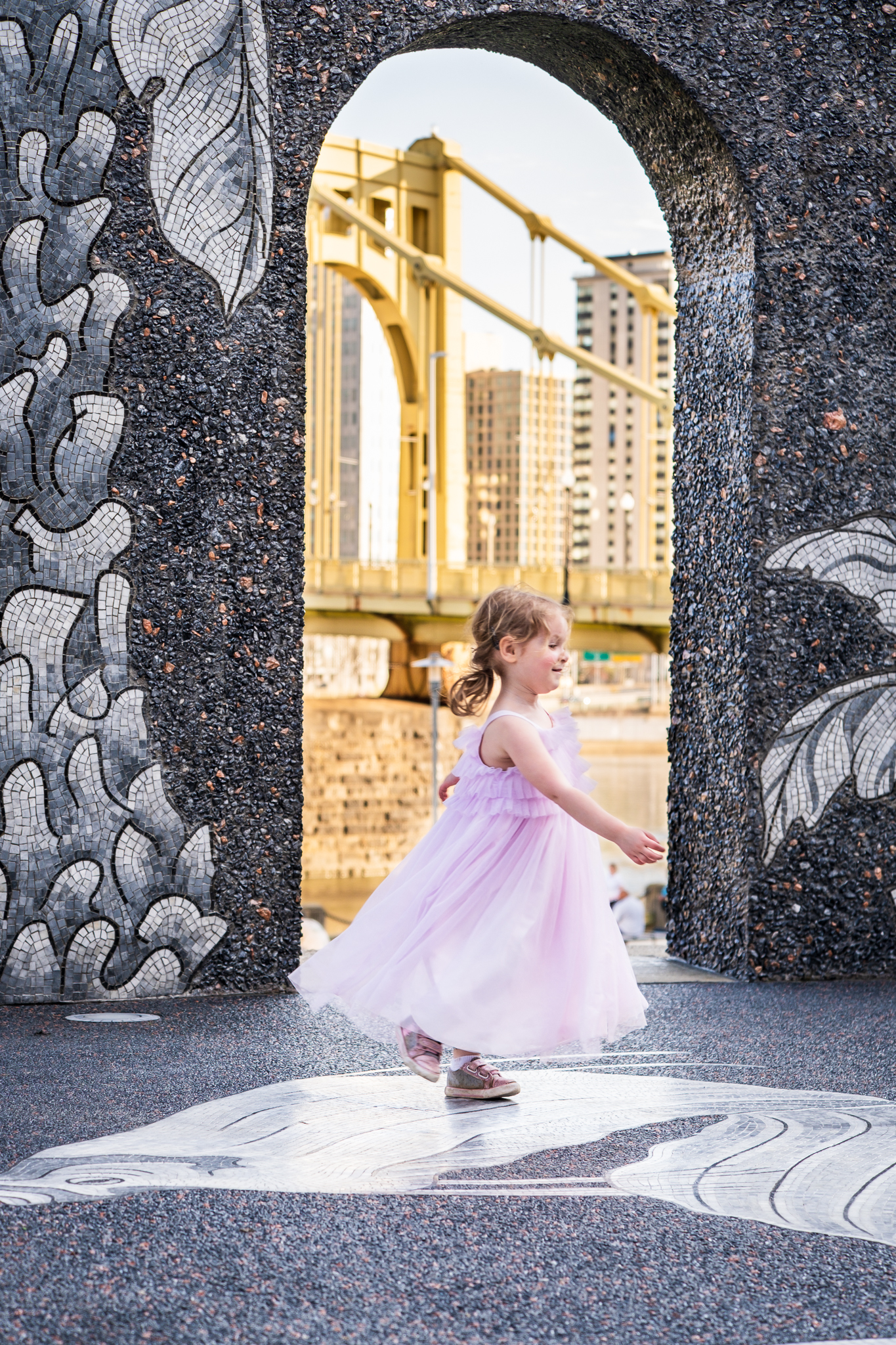 girl spinning in dress at north shore pittsburgh