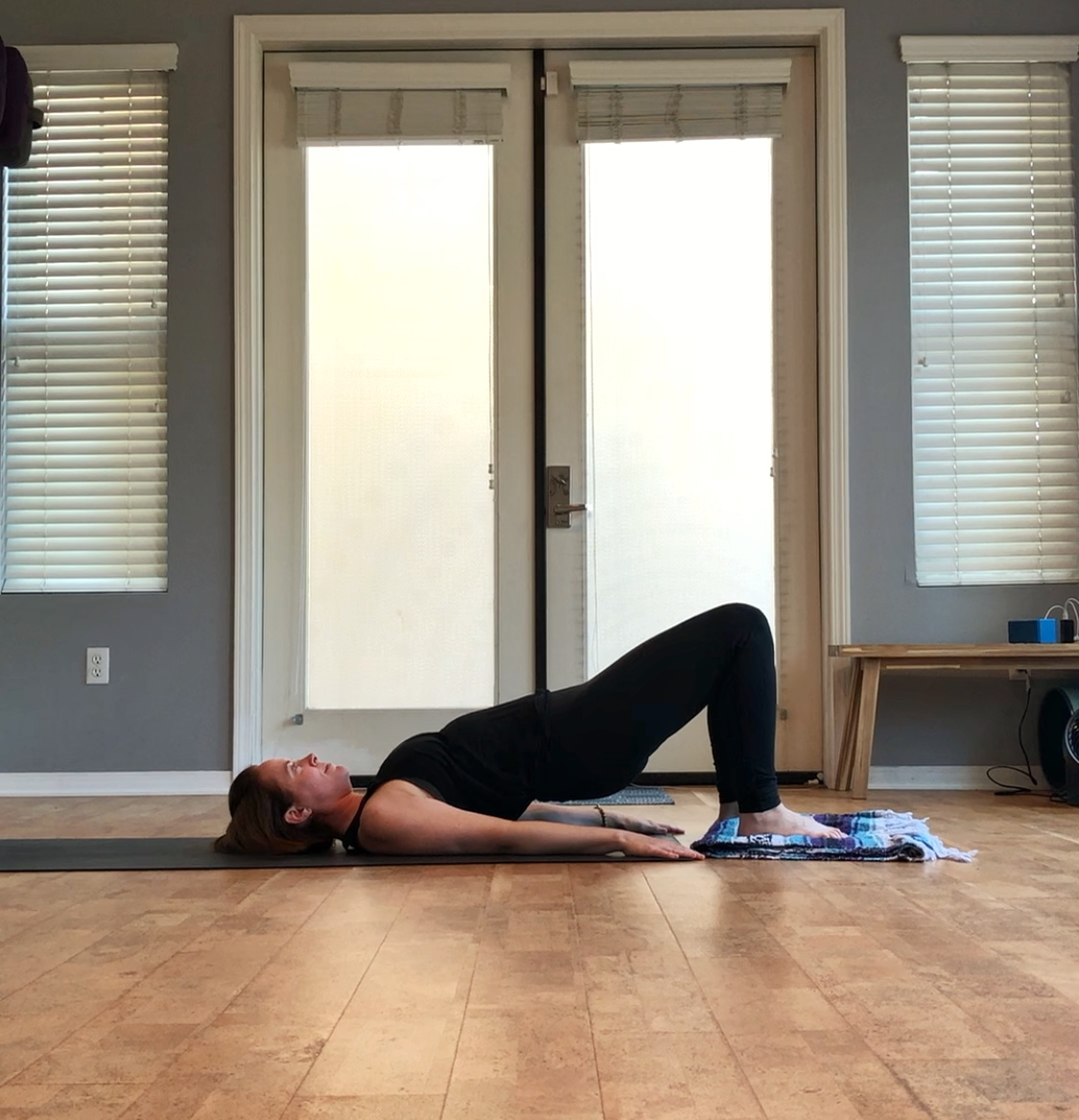 - Lift your hips into bridge, then slowly push your feet away from your body.  Pull your feet back to your body.  Beware, you may get a cramp when you do this one!  If so, lower your hips and take a break.