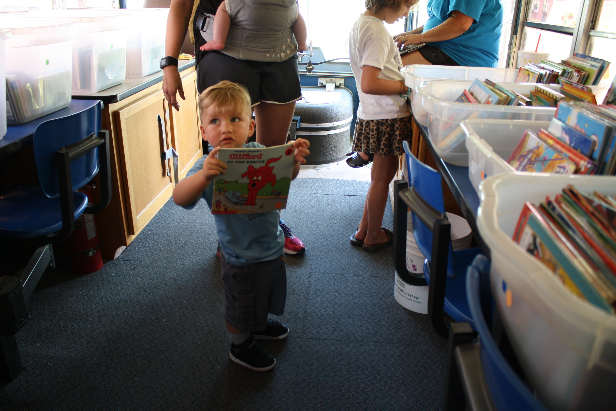 Readers of all ages enjoy the Summer Bookmobile Mondays and Wednesdays in July.