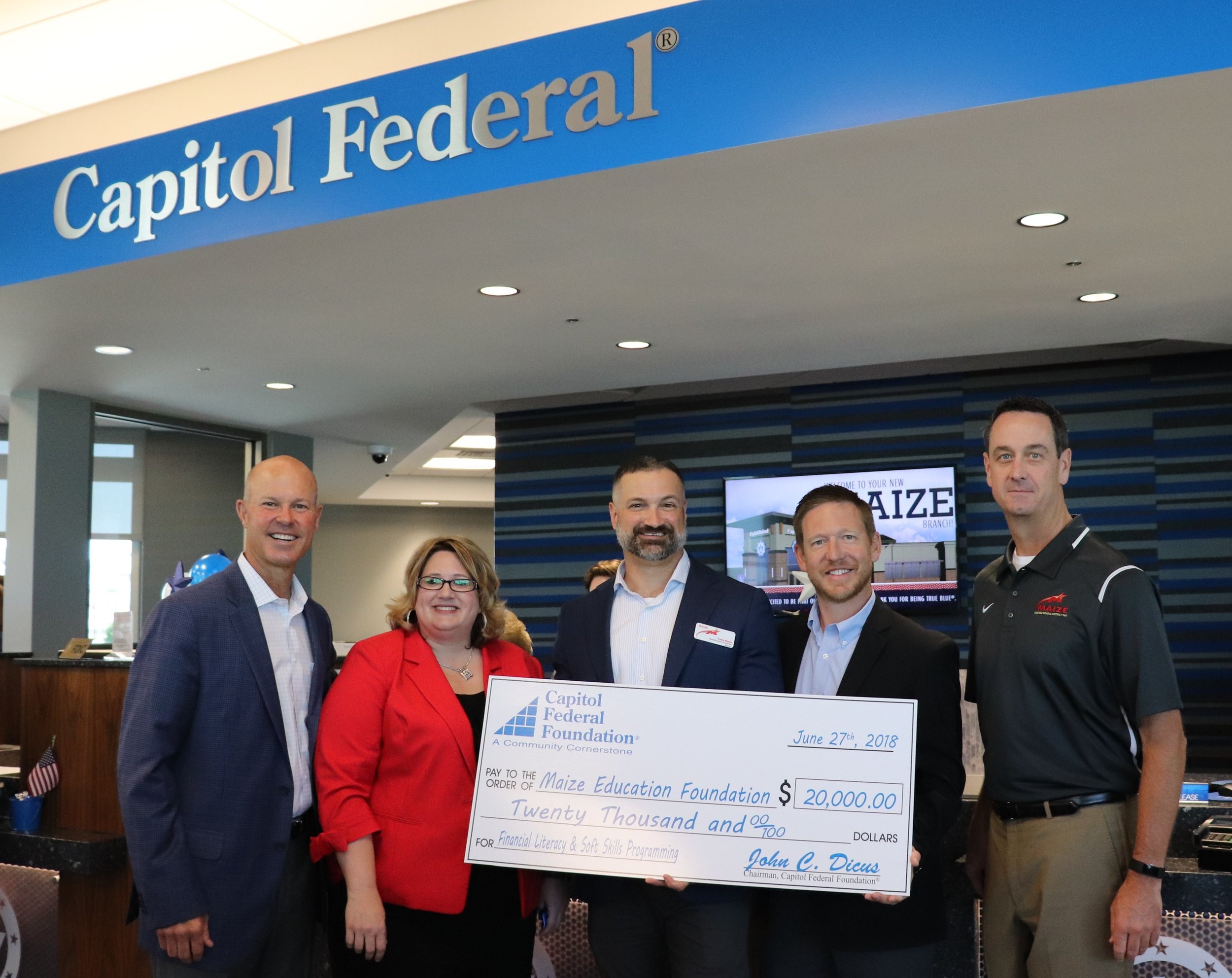 Pictured from left to right: Capitol Federal® CEO John Dicus, Capitol Federal® Branch Manager Jennifer Gorman,Travis Bloom,Maize Education Foundation Vice President Brandon Brungardt,and Maize Superintendent of Schools Dr. Chad Higgins.