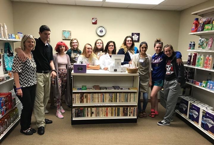 CHSM General Store students and instructor, Michelle Hilliard, at Reflection Ridge Retirement Community.   Learn More→