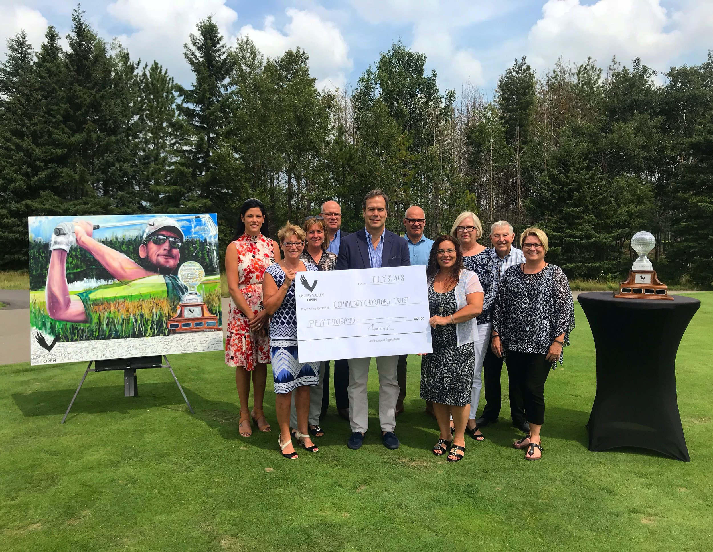Representatives from the Town of Caledon, Credit Valley Conservation Authority, Bethell Hospice Foundation, Caledon Community Services and the Osprey Valley Open presented by Votorantim Cimentos - CBM Aggregates pose with a cheque for a $50,000 donation from the 2018 event.