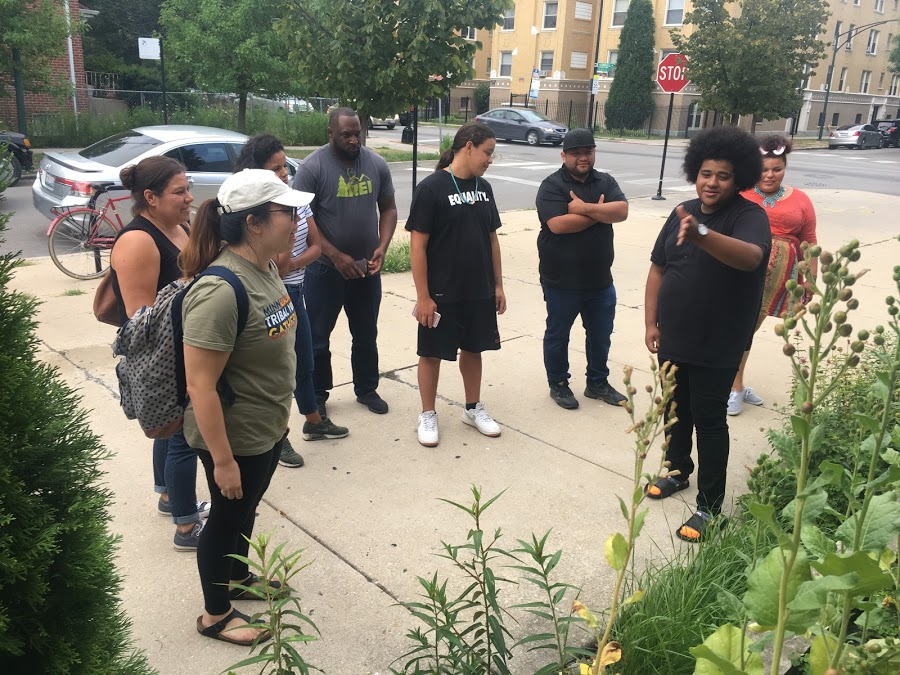 Fresh Tracks Trainer Anthony Tamez leads a tour of the medicinal garden outside the Chicago American Indian Center on the day before the Midwest Training in officially begins.