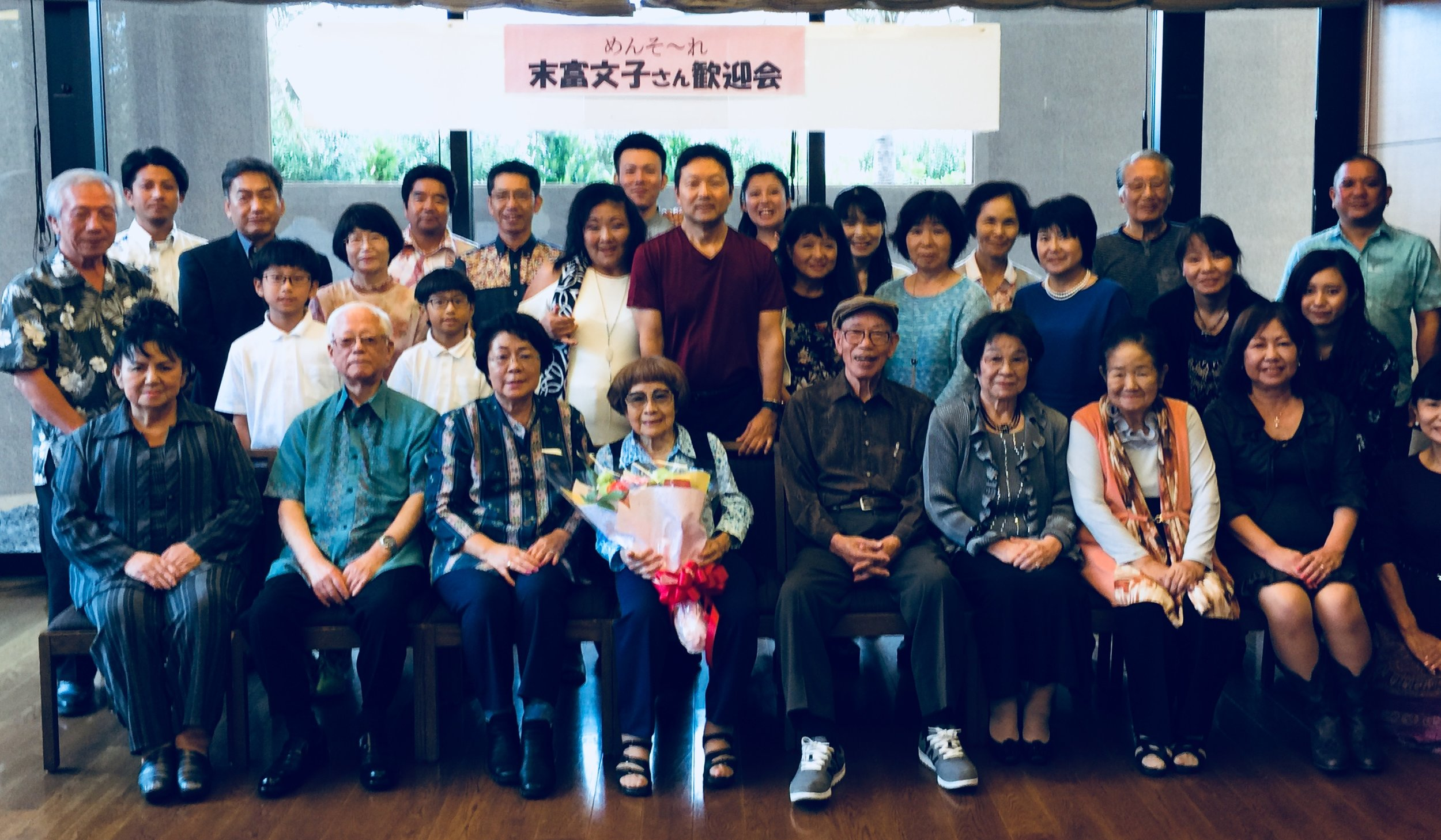 Janice Suetomi (seated fourth from the left, holding bouquet) was the guest of honor at a family reunion in Okinawa in November 2017.