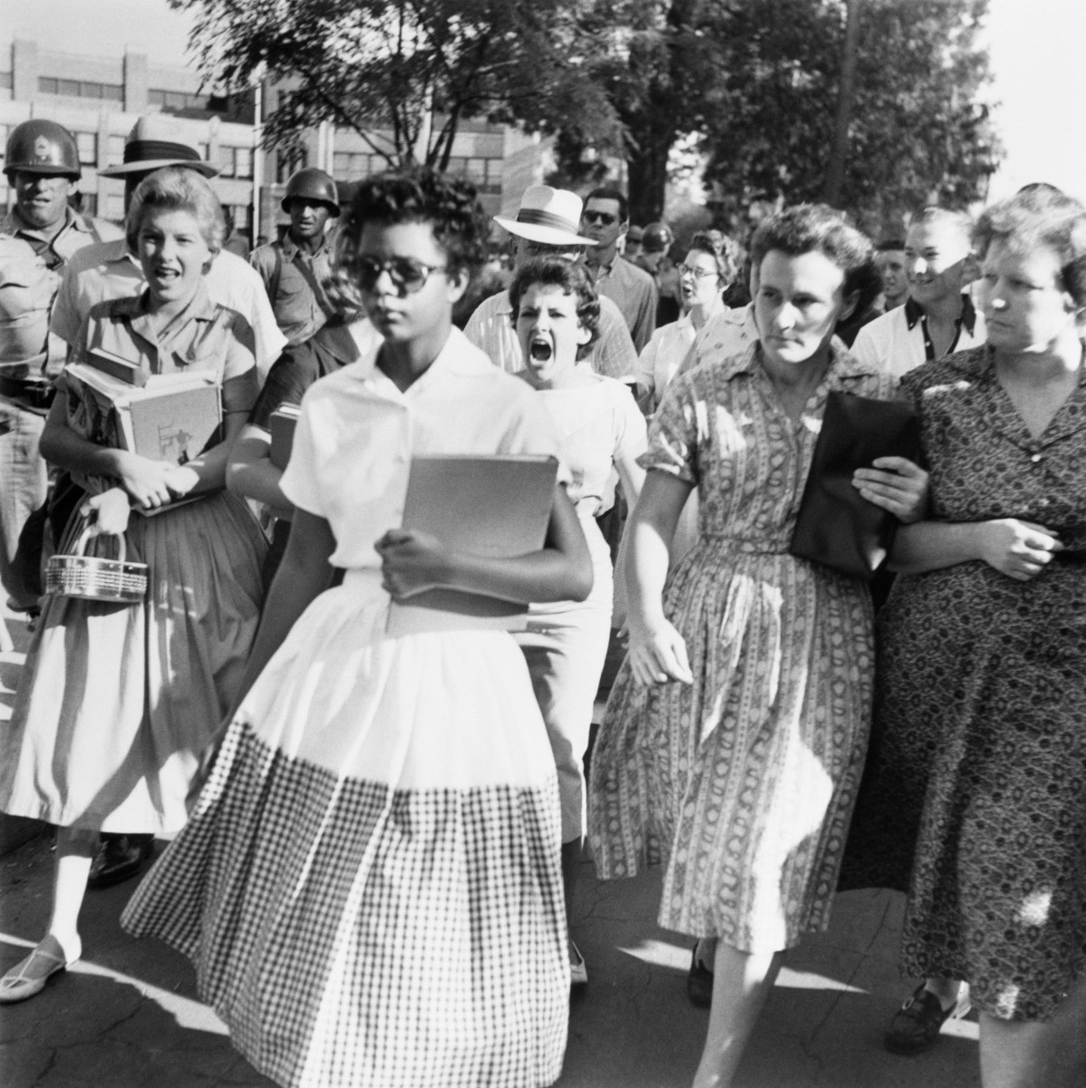 Elizabeth Eckford walks through an unwelcoming crowd on the first day of school.