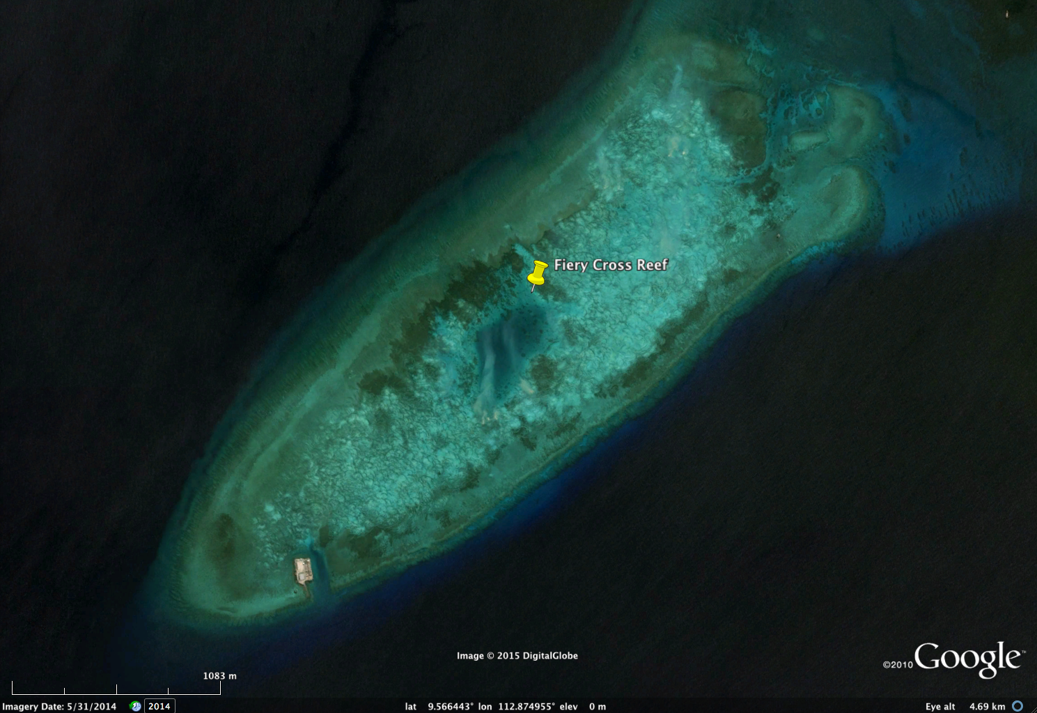 FieryCrossReef, May 31, 2014. Note the only man-made structure (small platform) at the bottom left of island. Light green and light blue areas are coral reef or adjacent habitat. Image copyright DigitalGlobe, via Google.