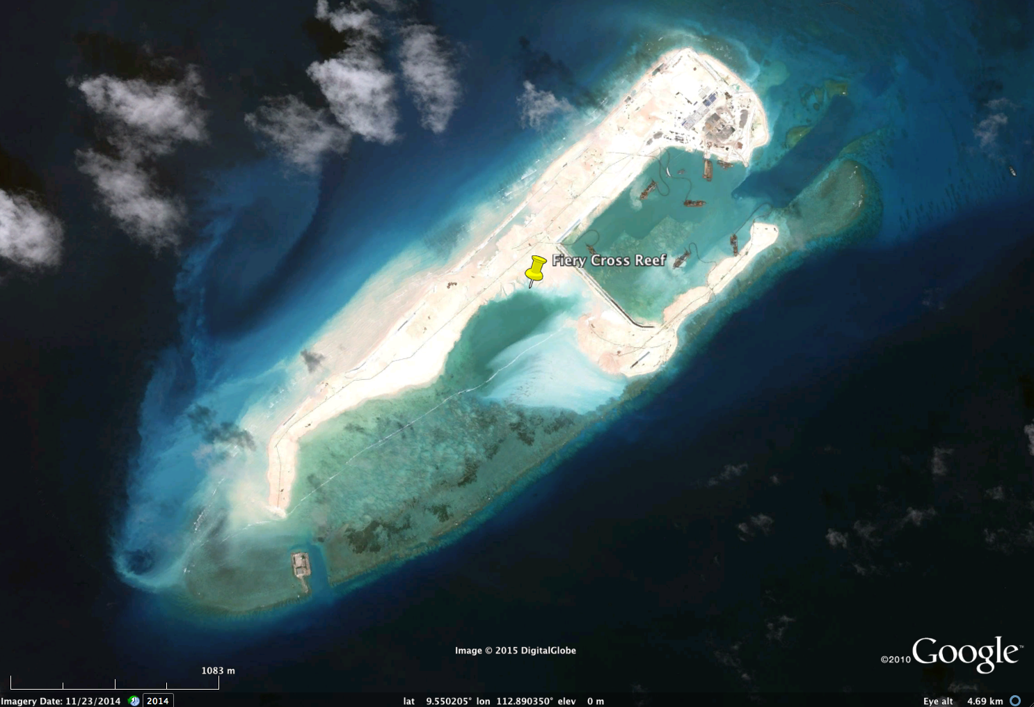 FieryCrossReef, Nov.23, 2014. Bright white and light brown areas are 'reclaimed' land, i.e., where sediments have beendredged from adjacent seafloor areas and pumped on top of live coral reefs (which dieonce smothered). Note presence of dredge/pump ships within newly-created 'harbour'. Also note light blue wisps, which are likely sediment plumes, flowing away from the island.Image copyright DigitalGlobe, via Google.