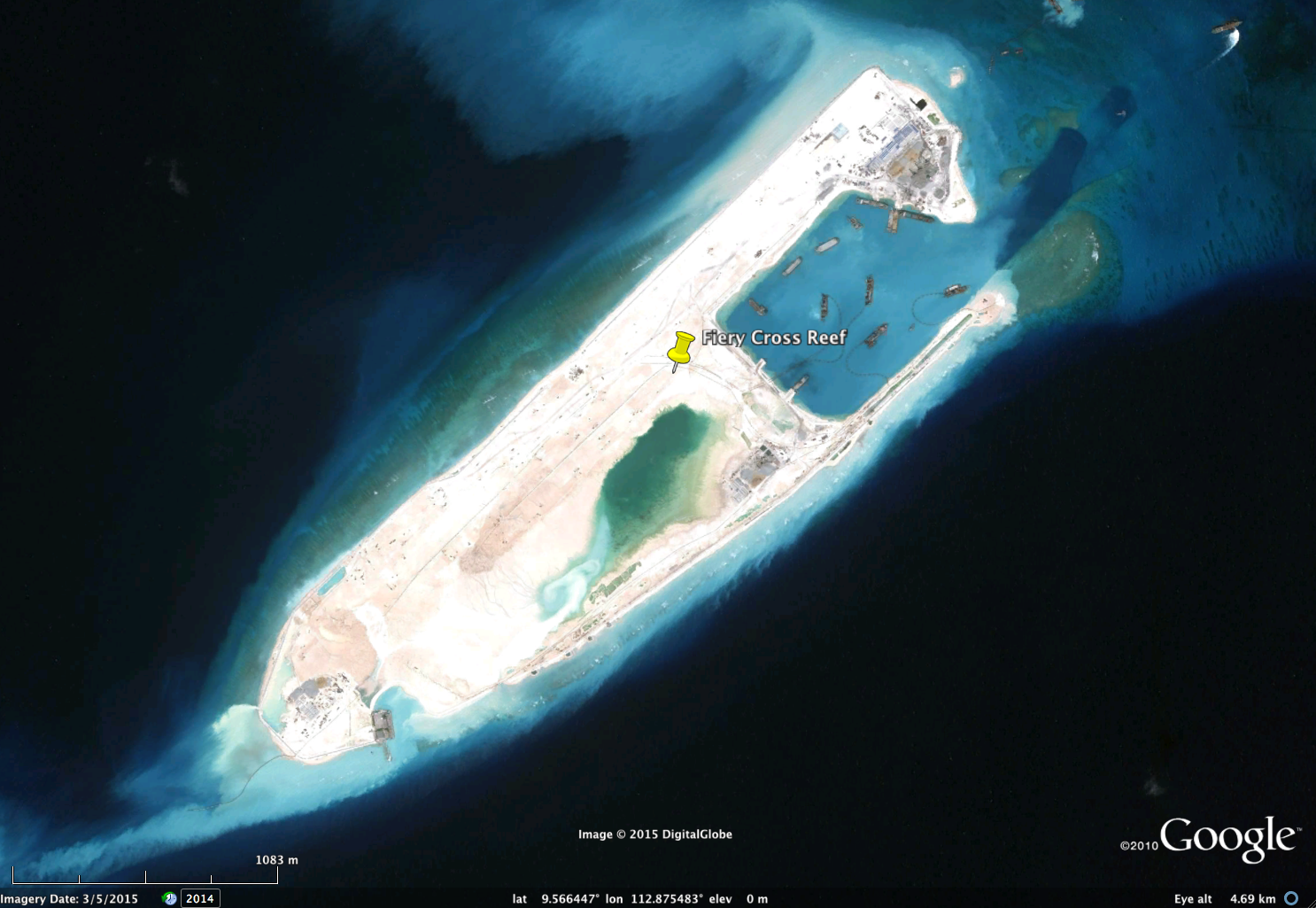 FieryCrossReef, March 5, 2015. Mostof the previous coral reef is now buried in sediment, creating a new 'island'. Image copyright DigitalGlobe, via Google.