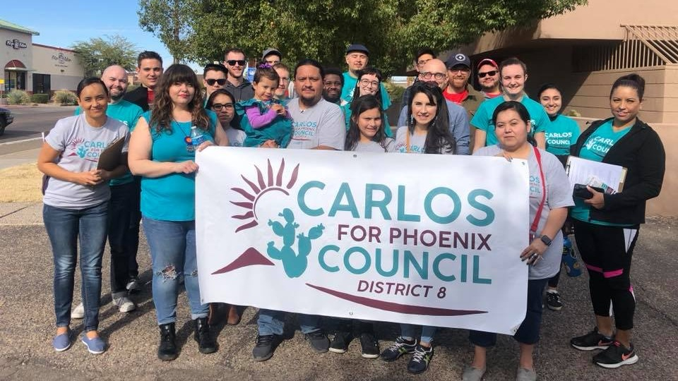 Carlos with Community Members at Canvass