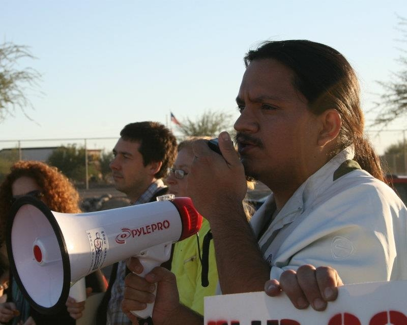 Carlos at Action with Megaphone
