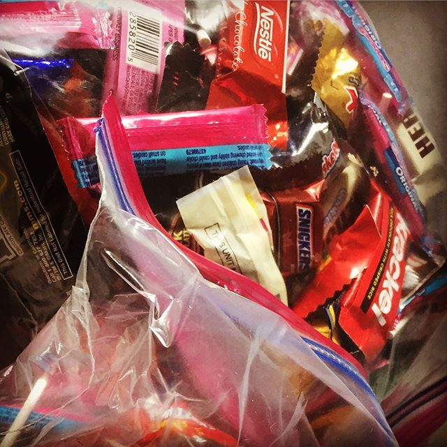 """The ever present Switch Witch dilemma: what to do with the abundance of Halloween candy collected.  This year I have found my hands in the candy stash way too much. The results: acne breakouts, headaches, feeling heavy and tired, brain fog, and feeling dull emotionally. NOT WORTH IT.  It was hard, but I threw away 2 gallon sized bags of candy—including Snickers, Reece's, Twix and Kit Kats (my faves!). I felt guilty for wasting and I felt torn to toss a """"treat"""" that couldn't hurt every once in awhile. But the truth is, I don't just have one and the results on my body are just plain not worth it.  Tossing the candy was a commitment to my health!  #wechoosewhatwecreate #fuelingthefam #thisonelife"""