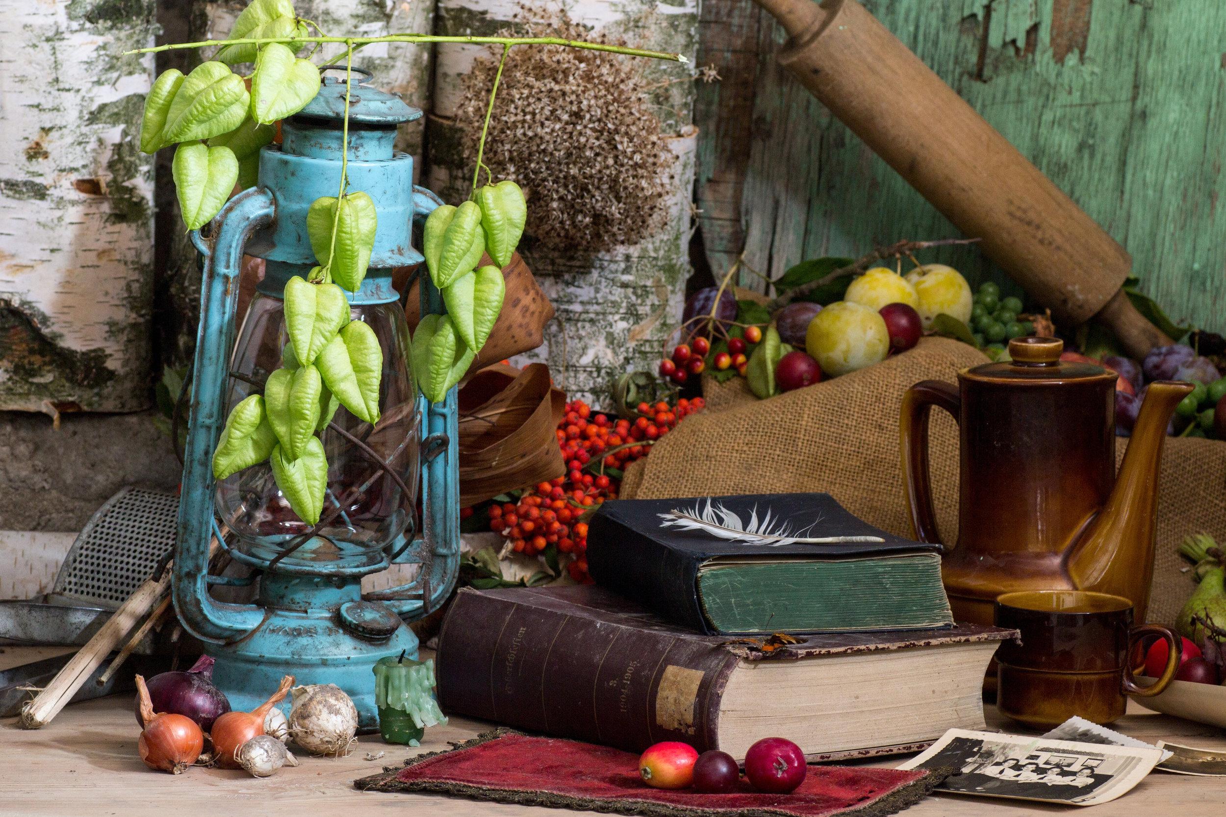 Canva - Still Life, Books, Old Books, Kerosene Lamp, Old Photos.jpg
