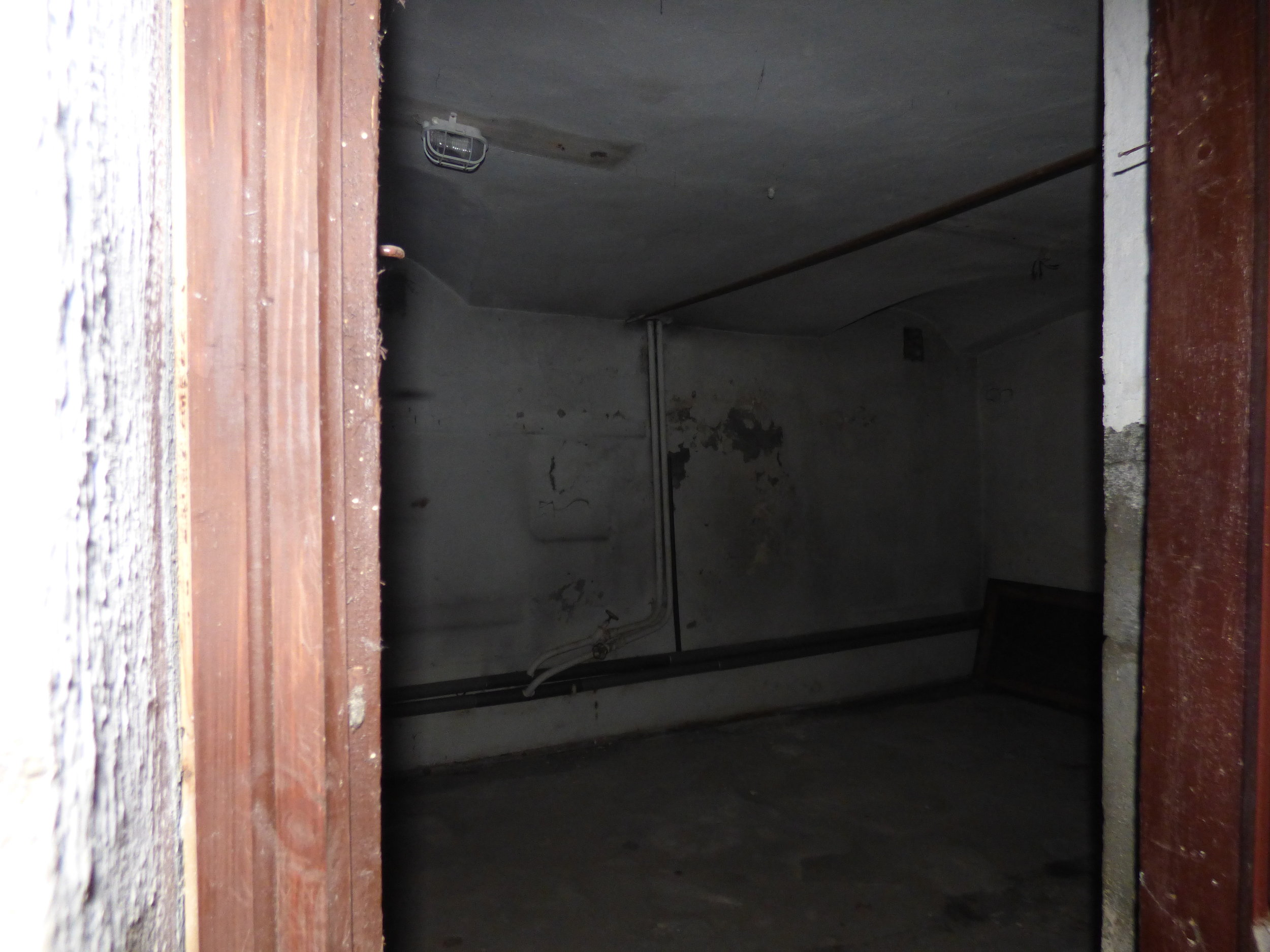 Entrance into one of the dungeons in the basement where many people spent their last days.