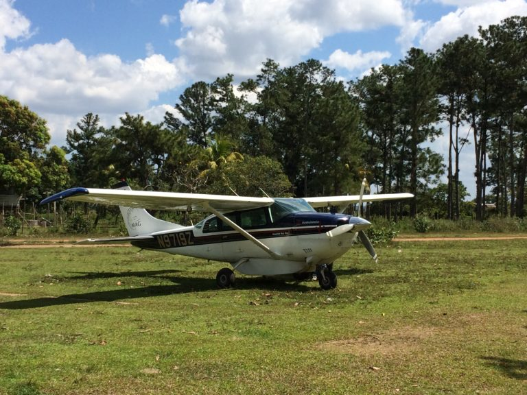 """MAG's Cessna 206 """"One Nine Zulu"""" in the village of Ahuas just after landing. The mission was to pick up more dental anesthetic from the Moravian hospital there to keep the dental team going in Rus Rus. Thanks for the help guys!"""