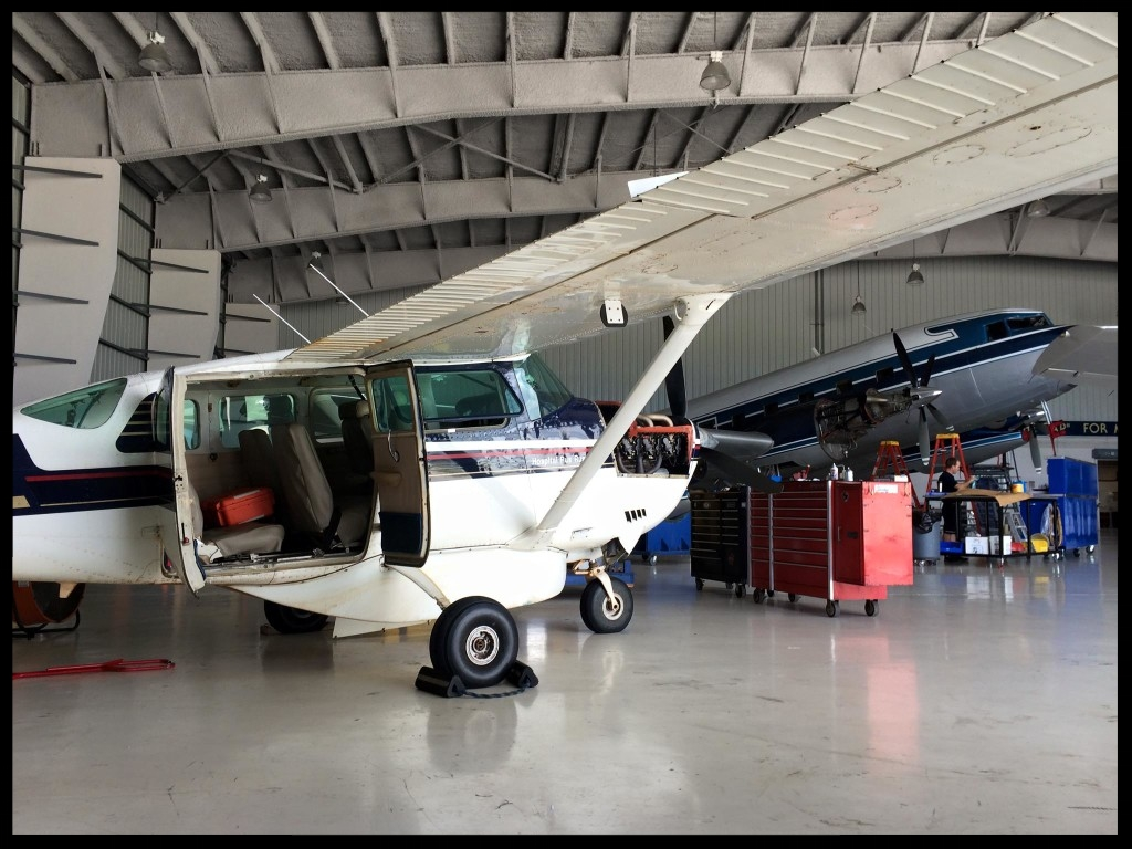 In the hangar at MFI in Ft.Pierce, FL, next to one of their turbine DC-3 aircraft.