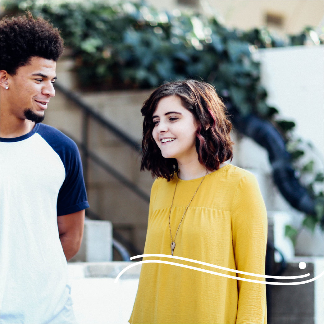 CRCC wave icon on a photo of a girl smiling wearing a yellow top and a boy looking at her smiling.