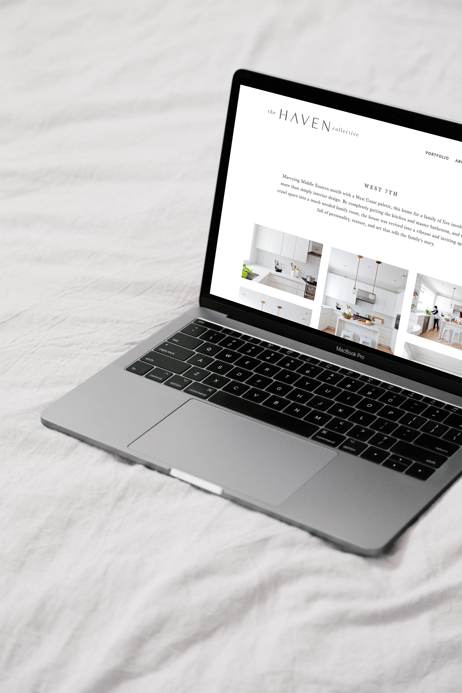 Haven Collective portfolio shown on a laptop on a bed