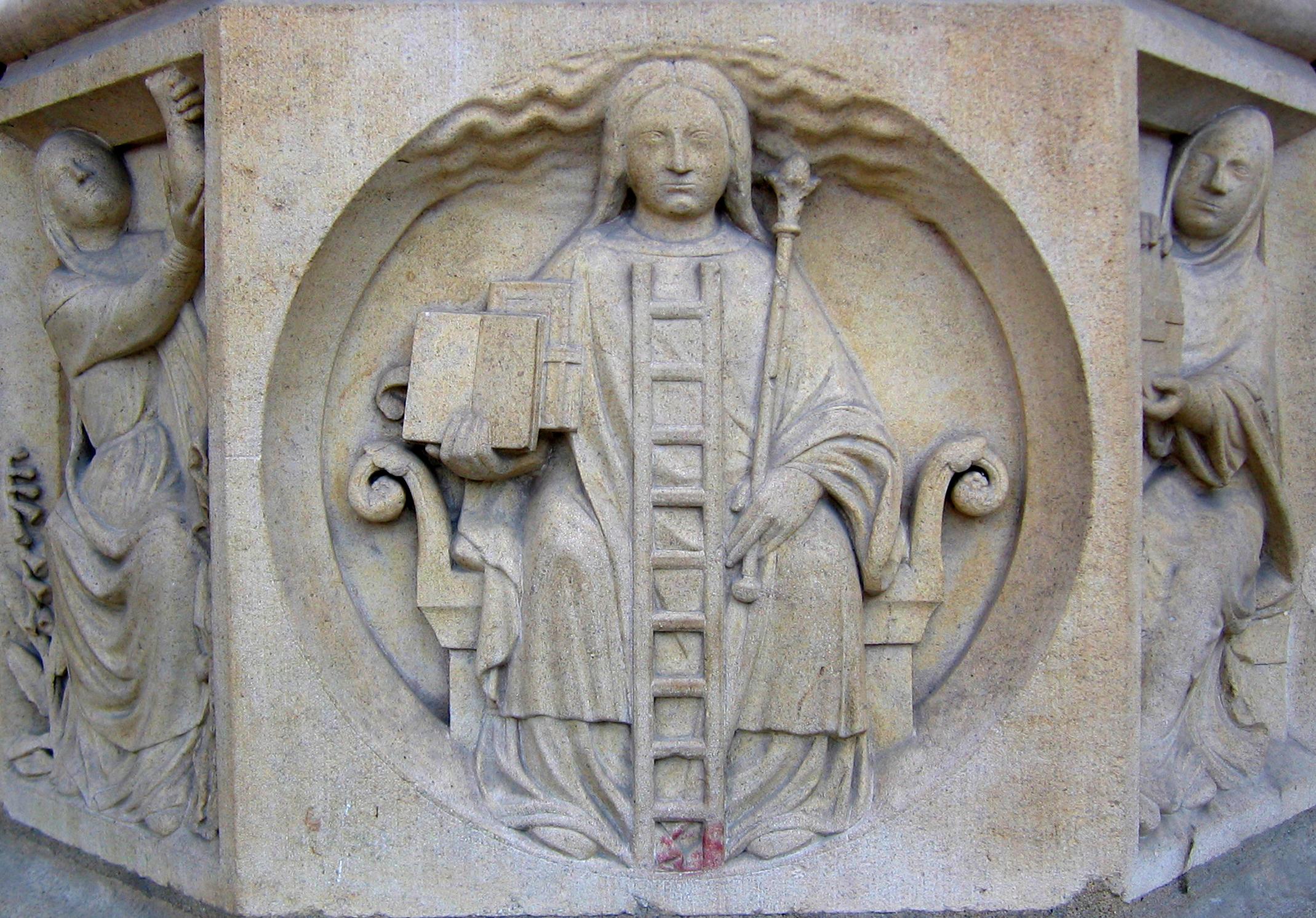 """""""Alegoría de la Alquimia"""". Relieve en el pilar de la entrada central de la catedral de Notre Dame de París. Autor Foto: Chosovi."""