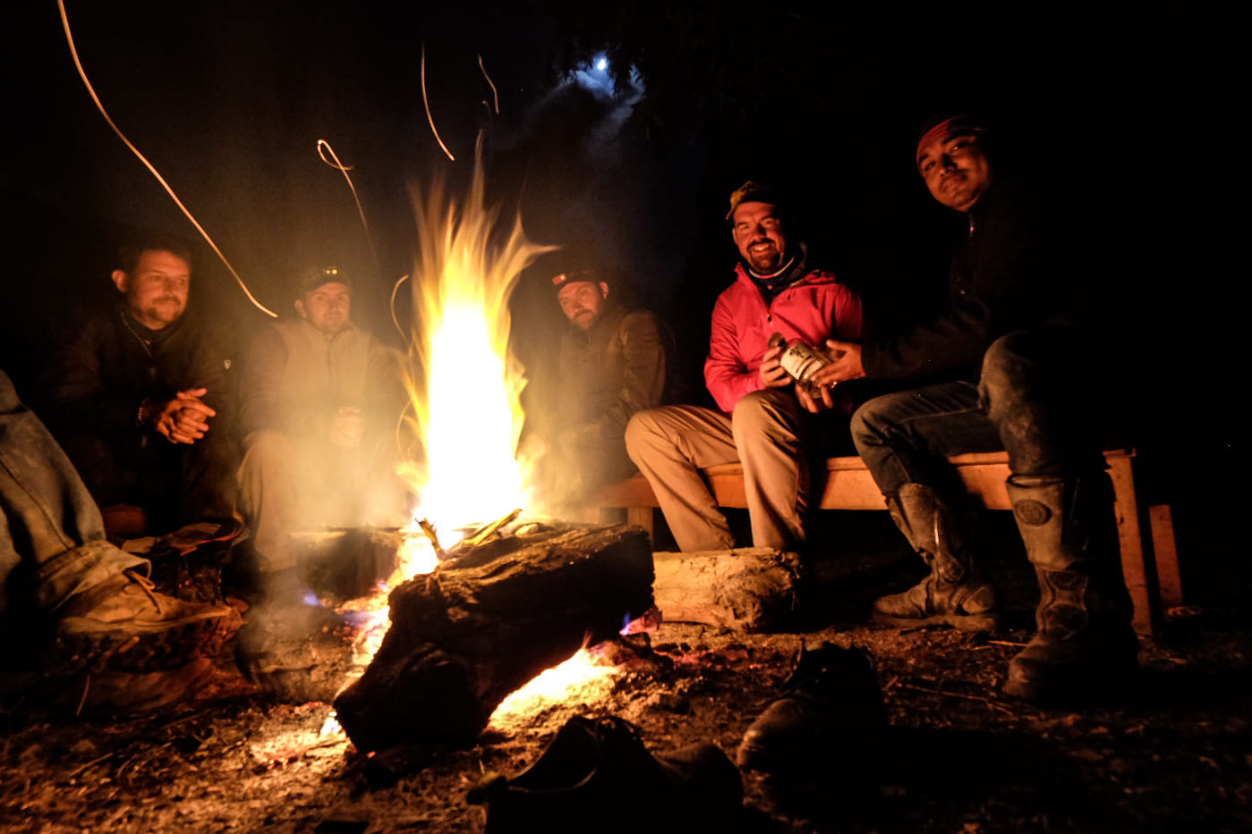 The best ideas are alway shared around a fire. Here our core team chats about the work ahead while traveling deep into Nepal's tallest Himalayan peaks.