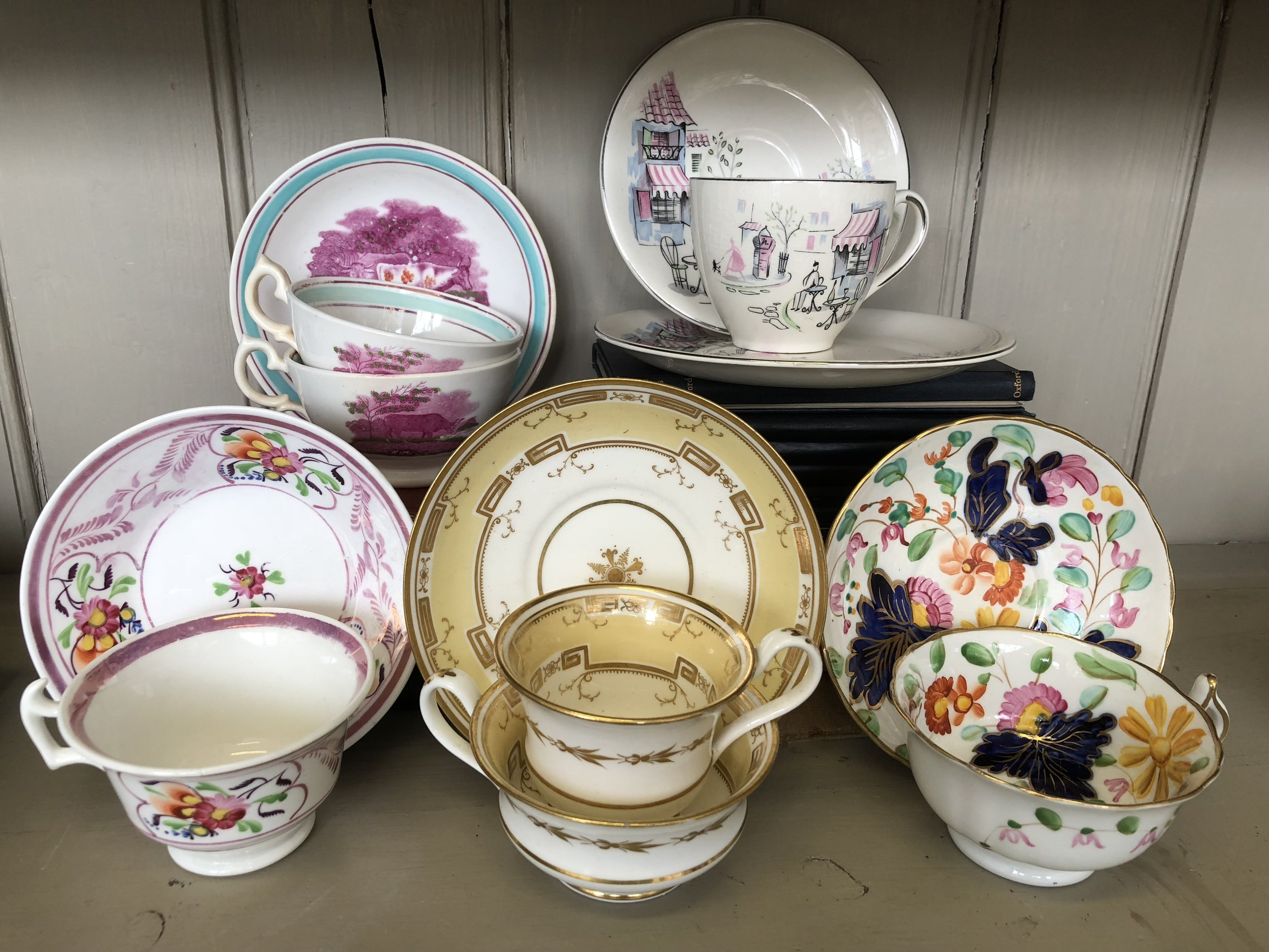 A selection of antique and vintage cups and saucers
