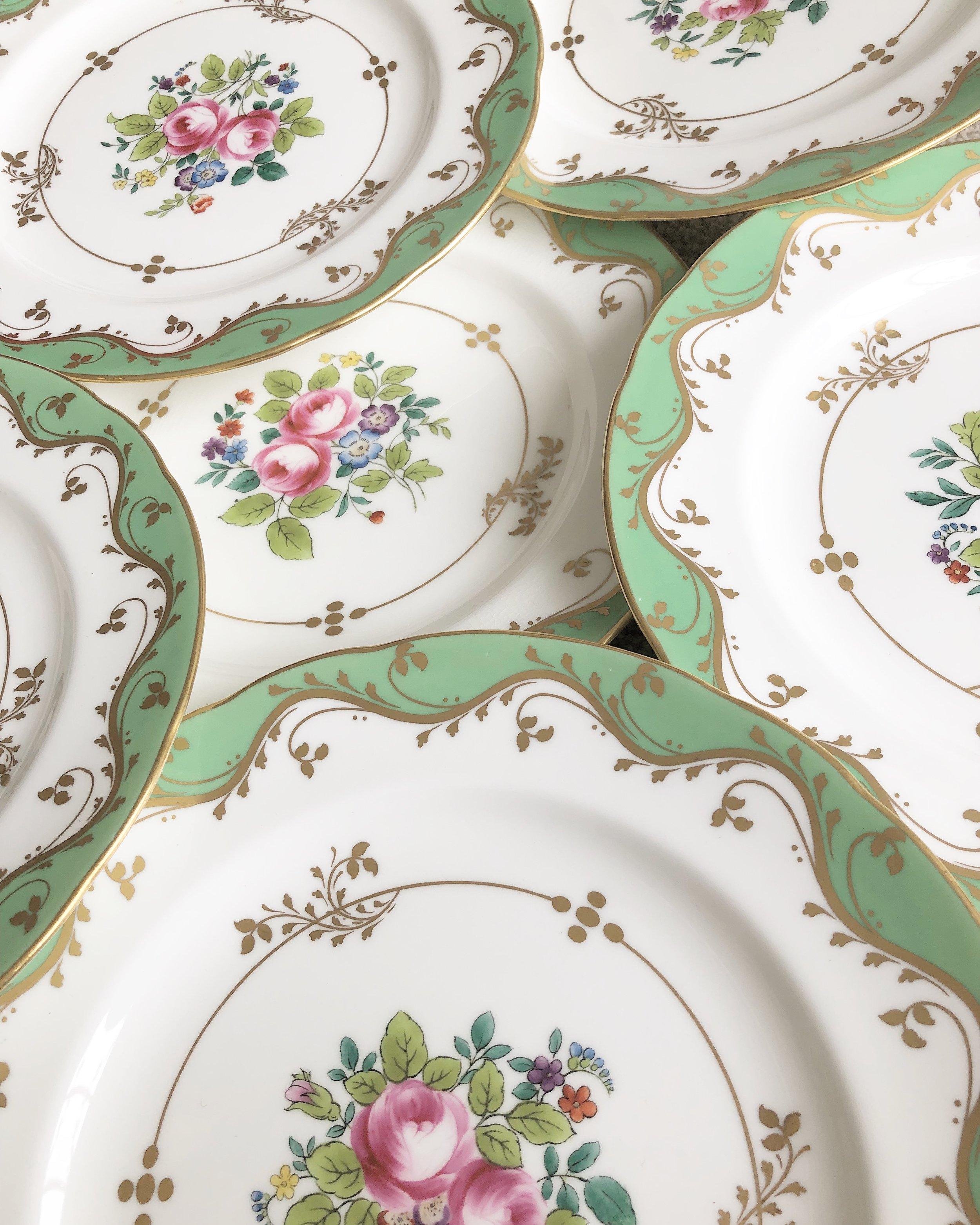 A set of six hand-painted antique Minton plates