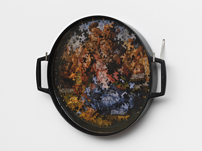 Tondo (Michelangelo)   cast iron pan, puzzle pieces, copper ball bearings  2019