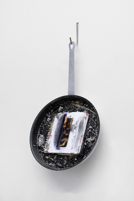 Tondo (Sketchbook)   frying pan, epoxy resin, studio sweepings, powdered graphite, spiral-bound notebook with collage  2019
