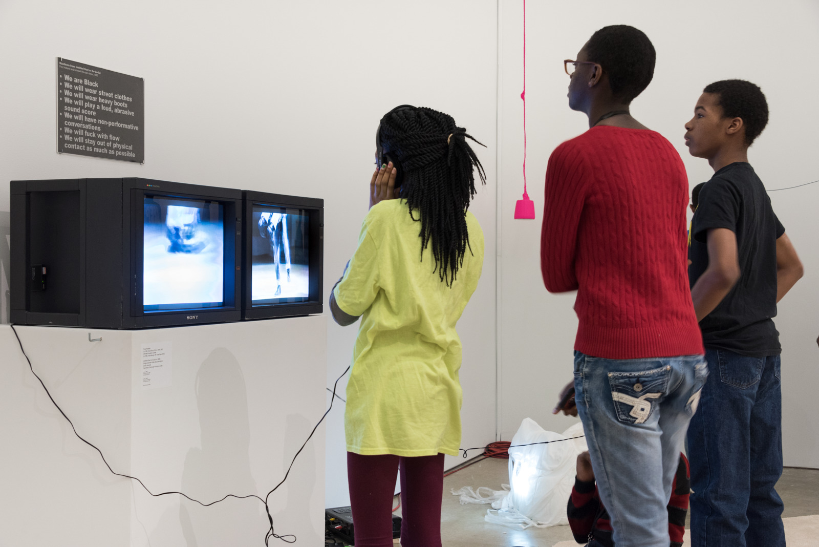 Installation of Fred Holland and Ishmael Houston-Jones footage of  Untitled Duet  or  Oo-Ga-La  (1983) on display as a part of  ENDLESS SHOUT: counts orchestrate, a meadow (or weekly practice with breath)  by taisha paggett at ICA Philadelphia (photographer unknown)