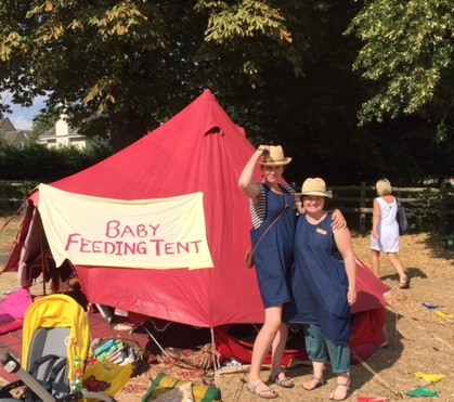 Here we are holding on to our hats (the wind was like someone opening an oven door!) at the end of a brilliant day hosting the baby feeding tent at Witney carnival.