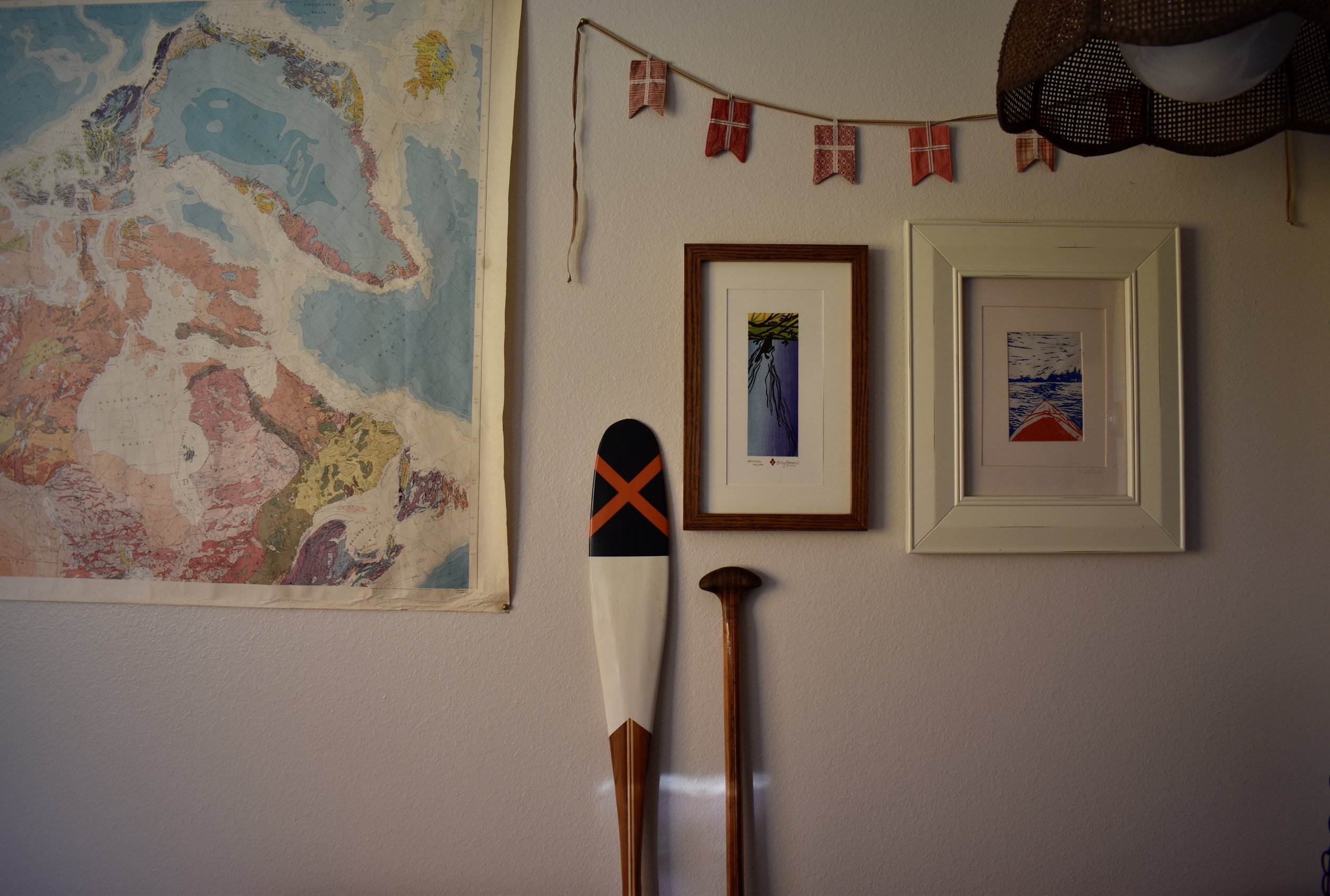 My current living space - filled with vintage maps and locally-made artwork and paddles, of course.
