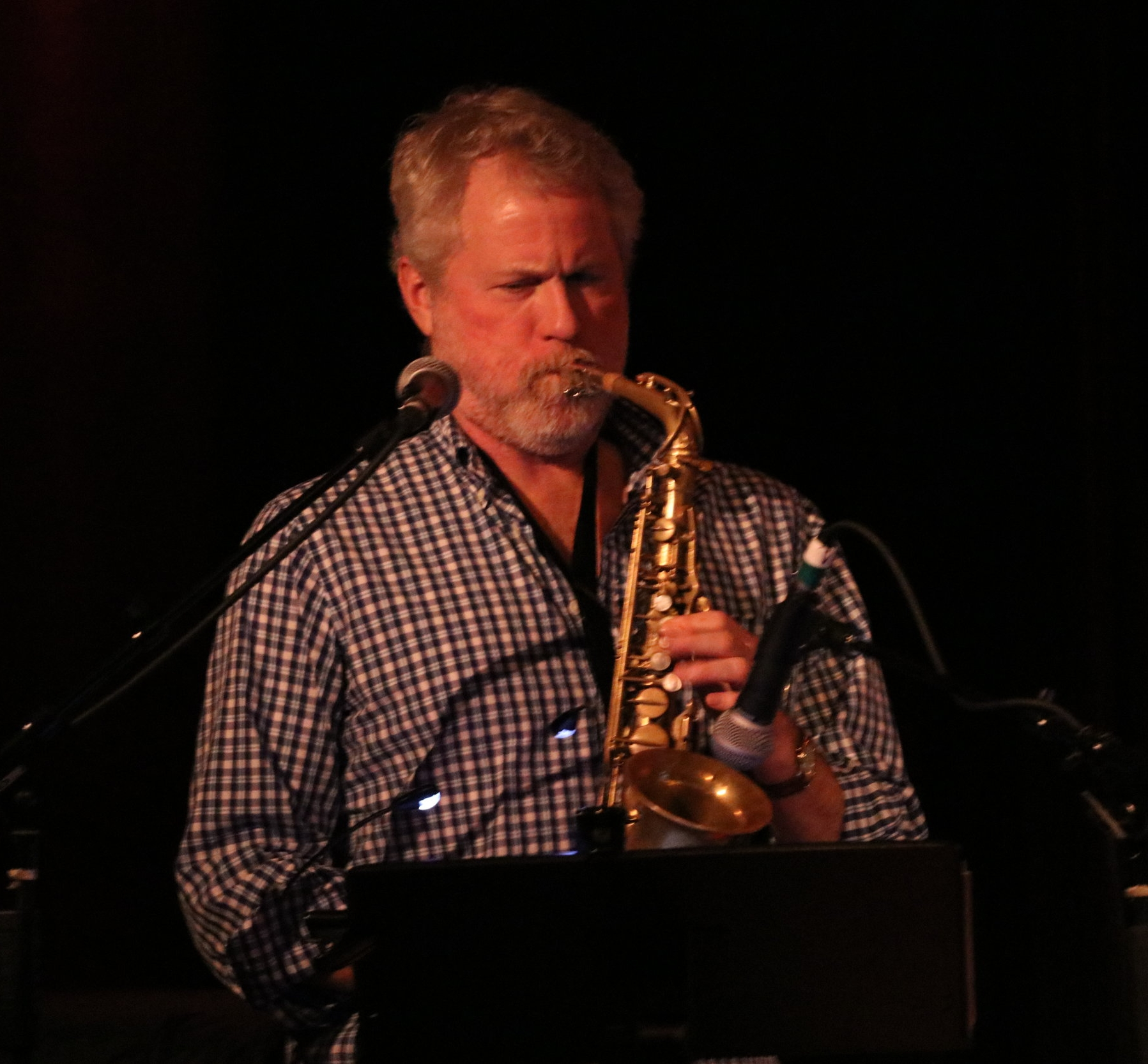 Bruce Gallagher   A career educator, performer and conductor,  Bruce of Whidbey Island provides a professional touch with his soaring solos and improvisations on saxes and flute, encompassing all styles from jazz and blues to rock and pop and beyond.