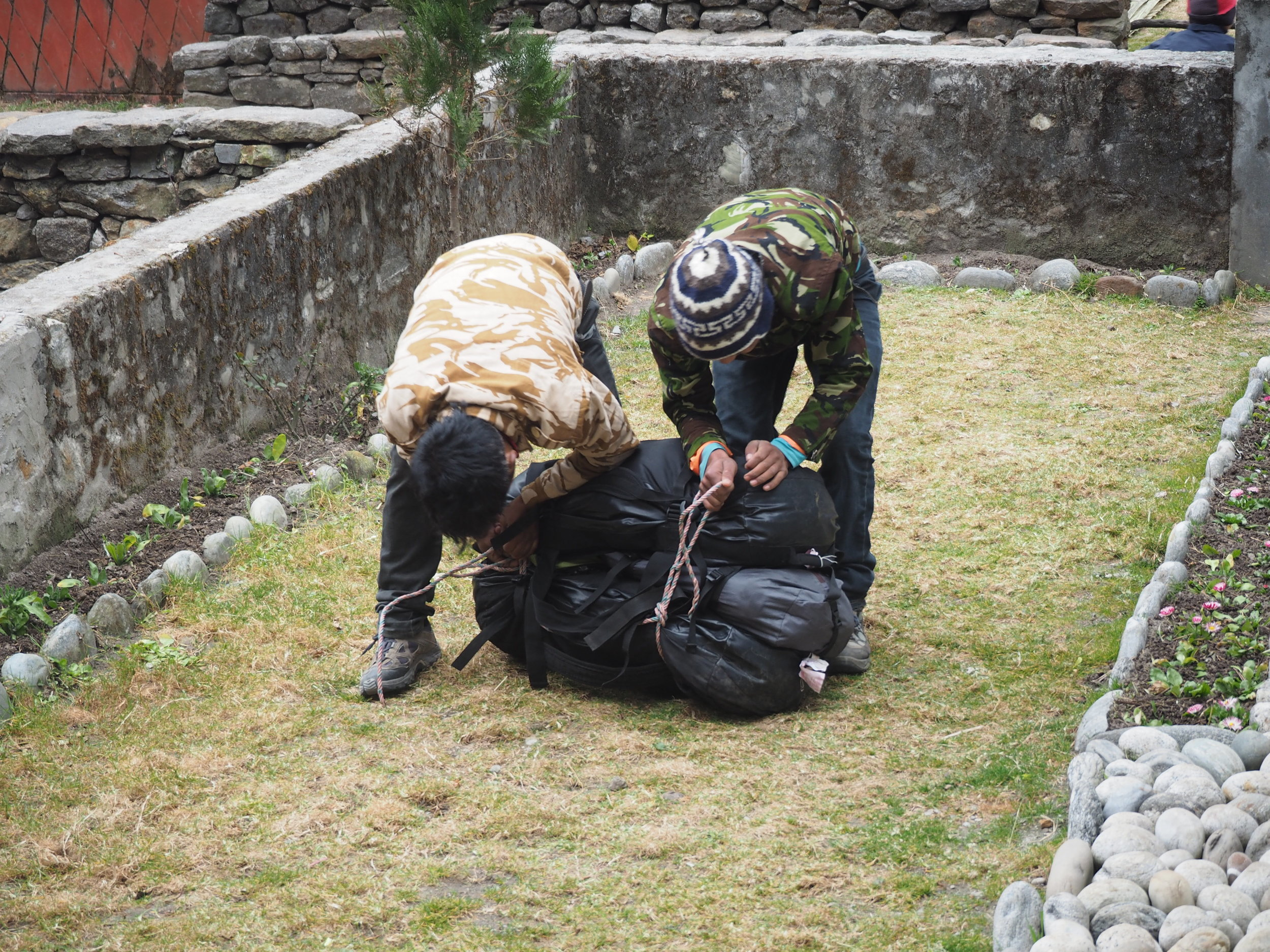 The porters on our trek getting our bags ready after our lunch break. Can you guess which one I married?