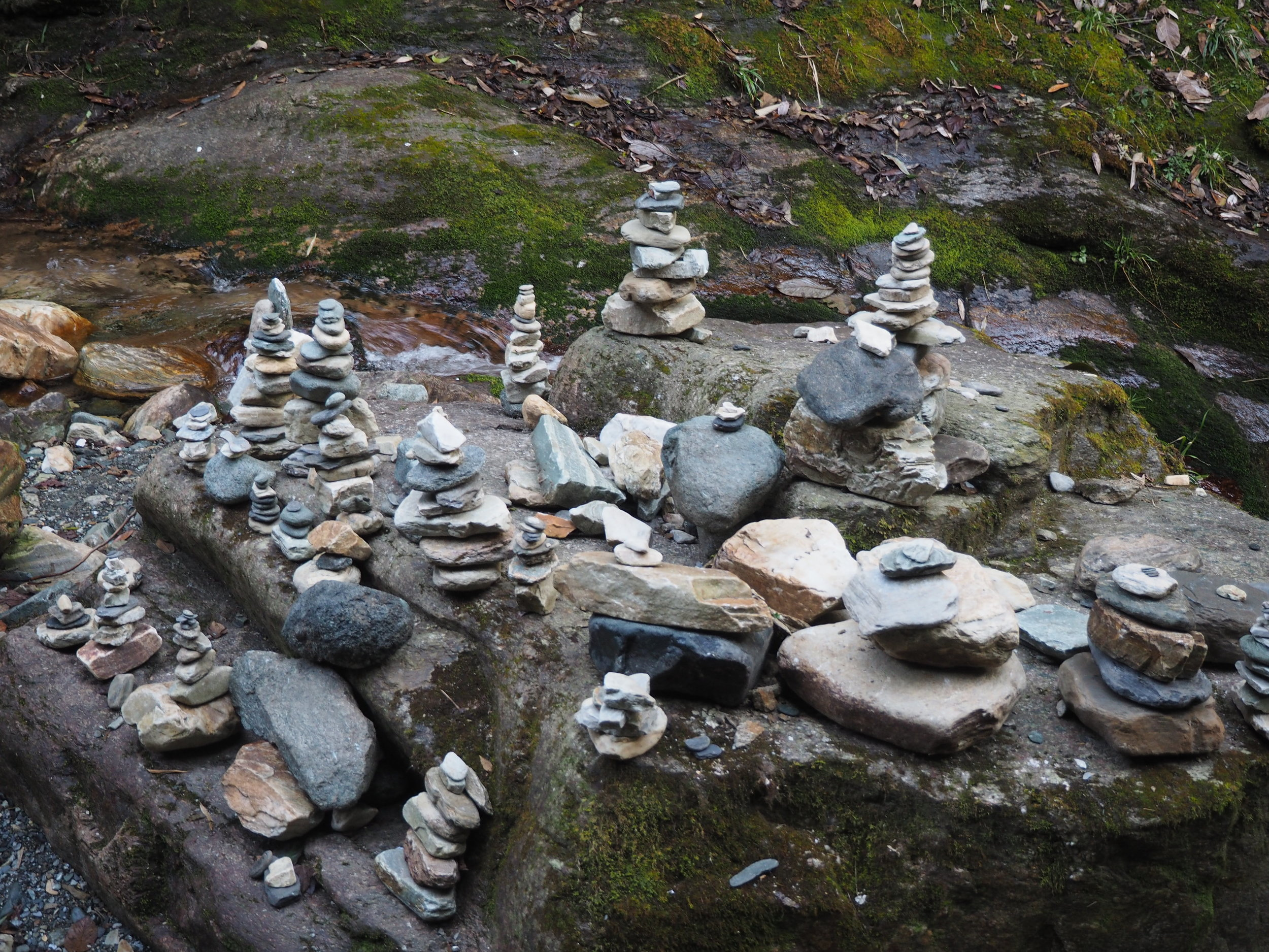Cairn Stones in the lush rhododendron forests lower down the Annapurna Circuit trail.