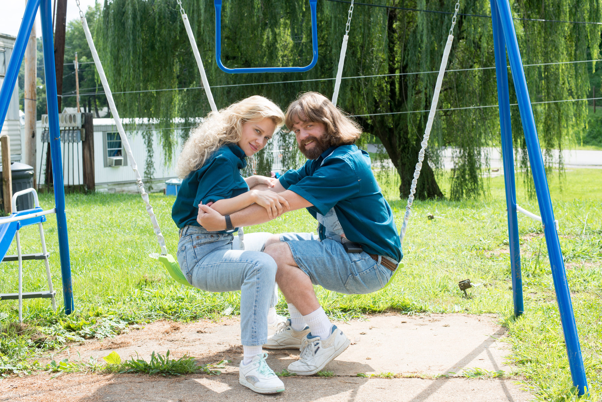 cheesy 80s engagemnt photoshoot from the Masterminds movie!