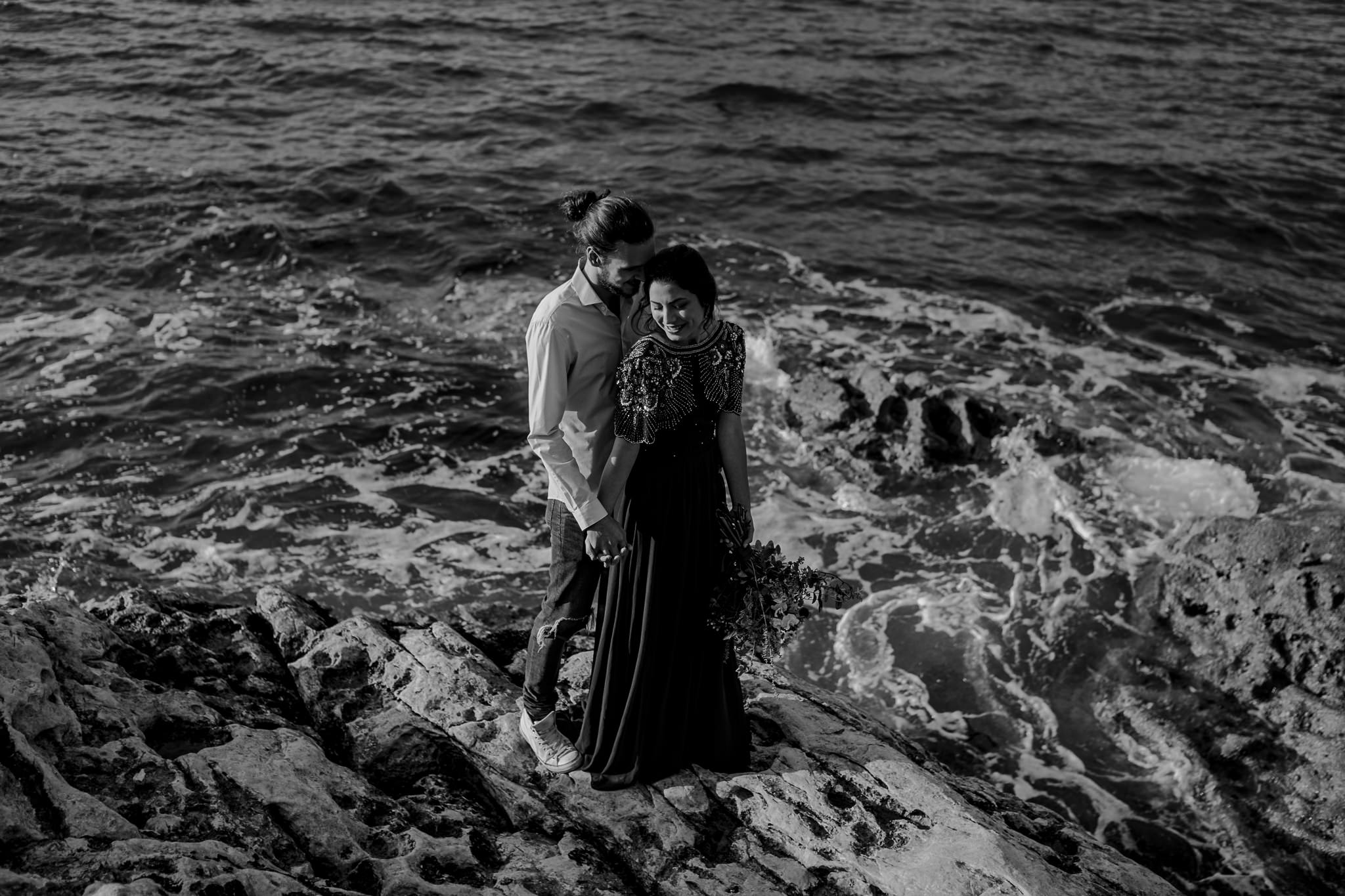 couple standing on the rocks on the North Coast during their pre wedding photoshoot