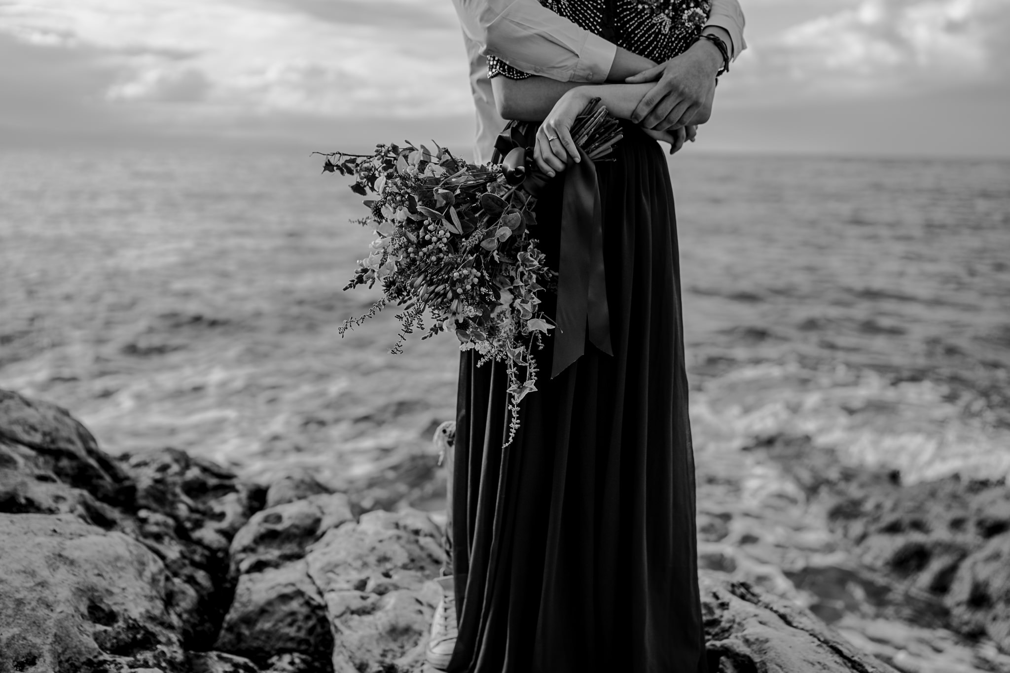 florist details bouquet couple hugging on the rocks of the North Coast Ireland