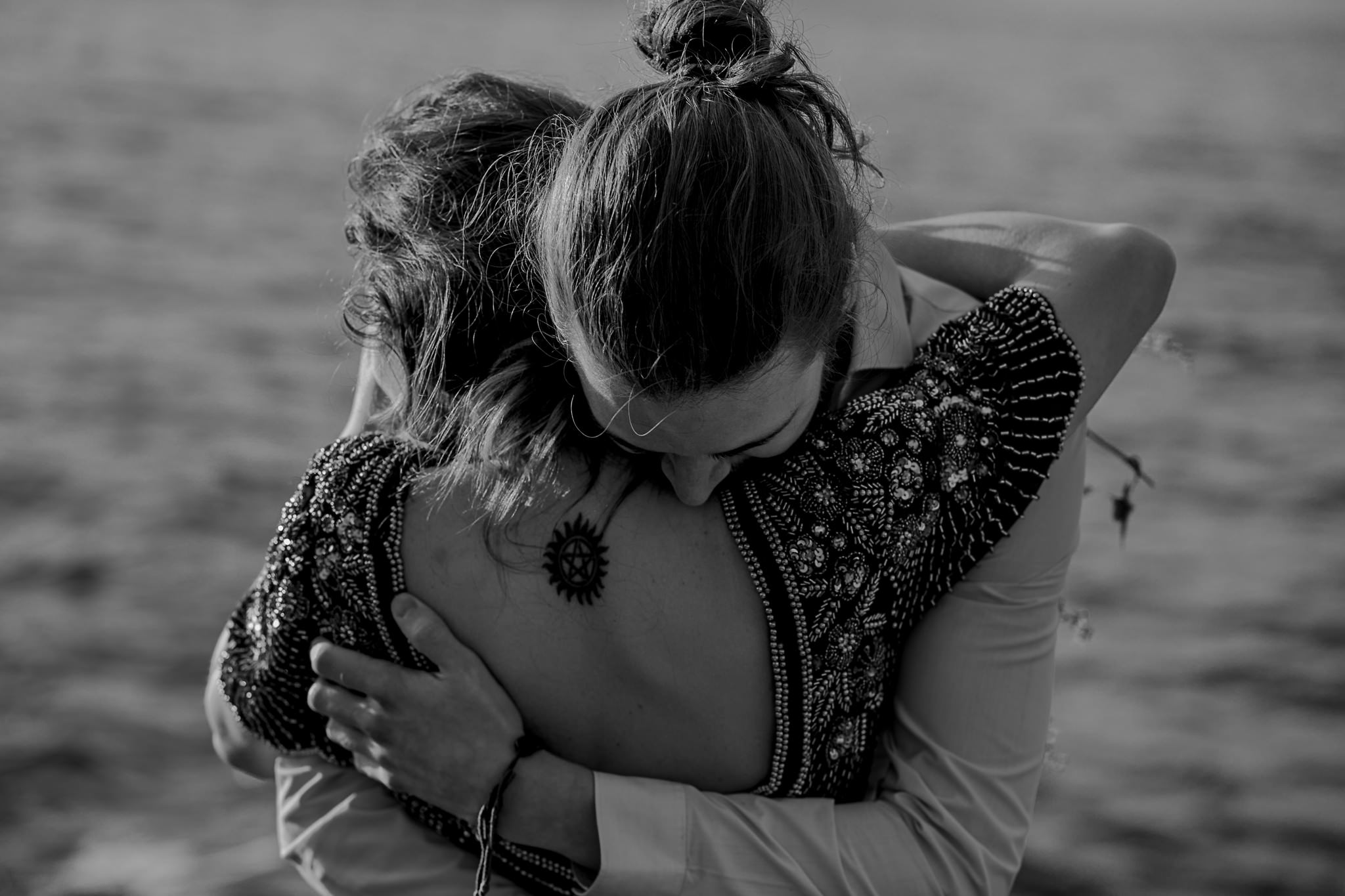 couple hug during their engagement shoot on the causeway coast