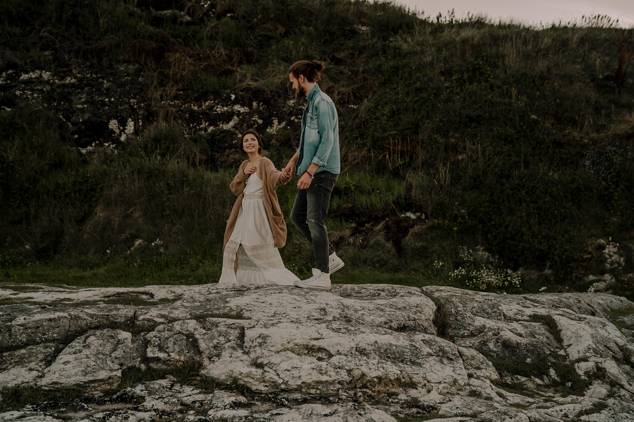 causeway coast hipster couple walking during their engagement photoshoot
