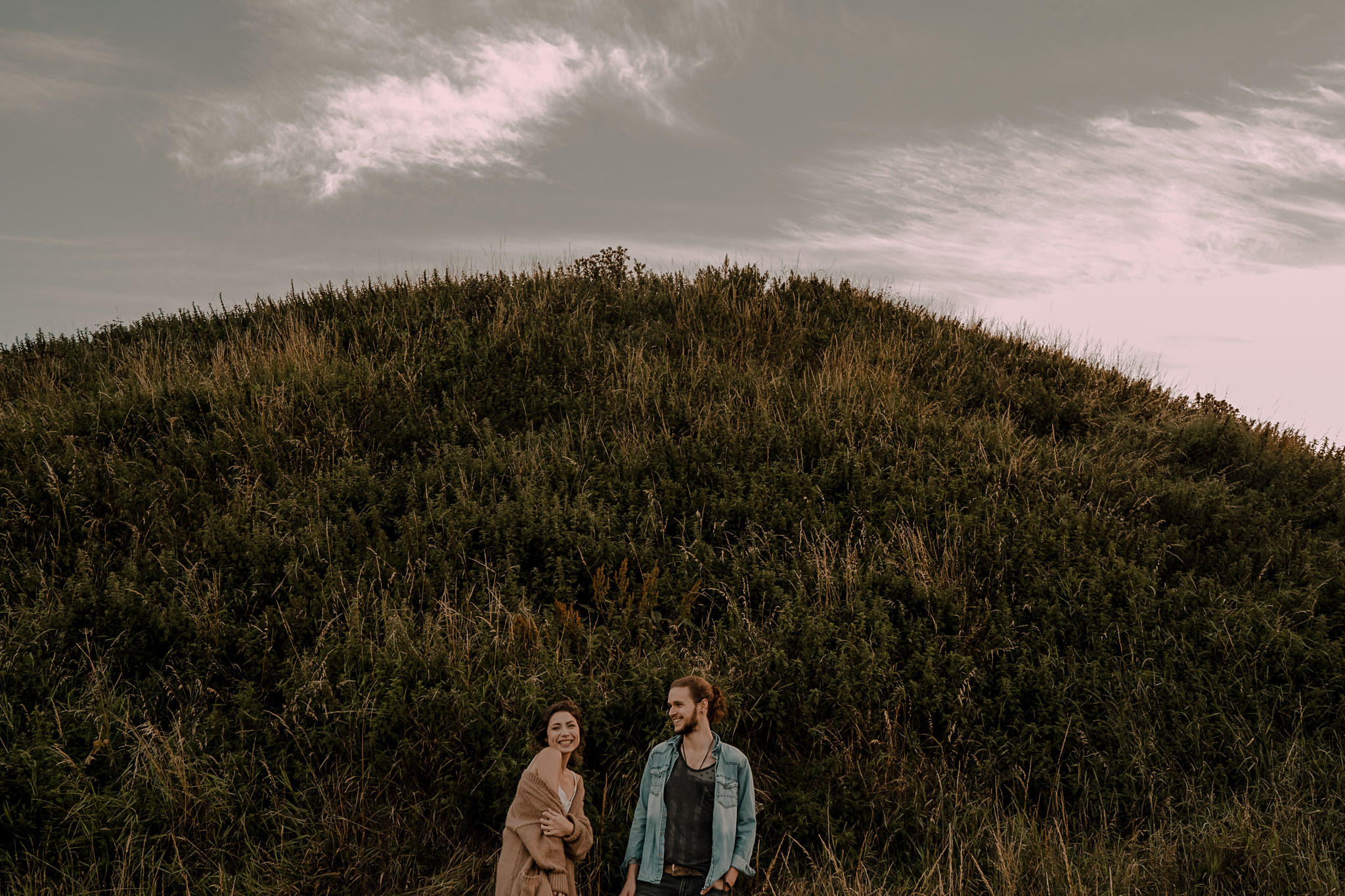couple laughing during their engagement session on the causeway coast