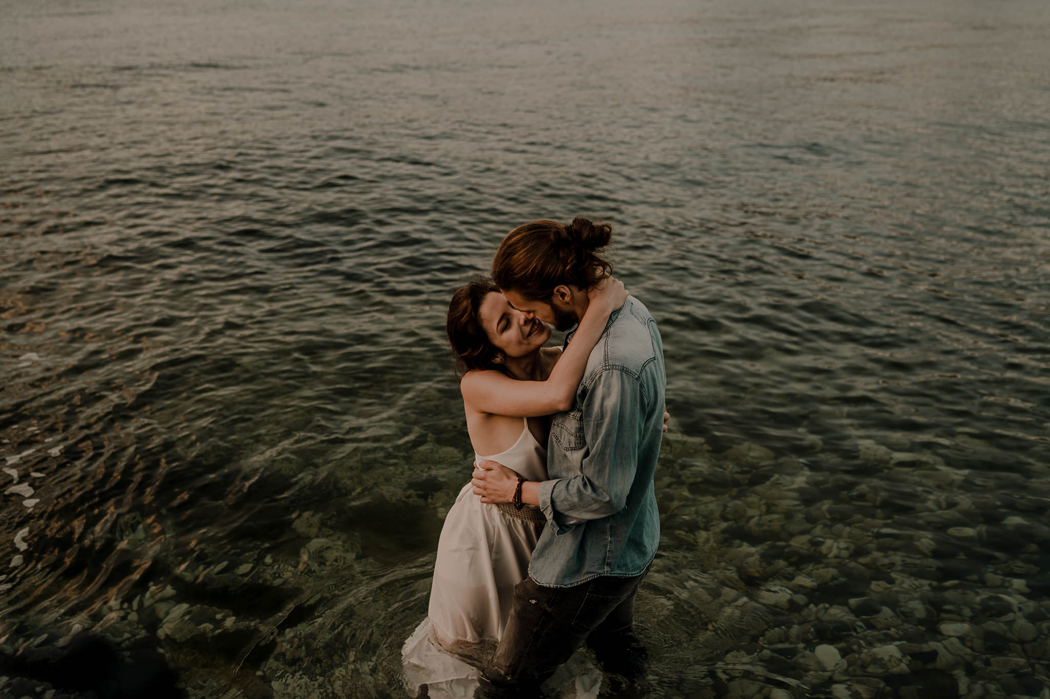 badass couple in the water on the North Coast during their engagement session