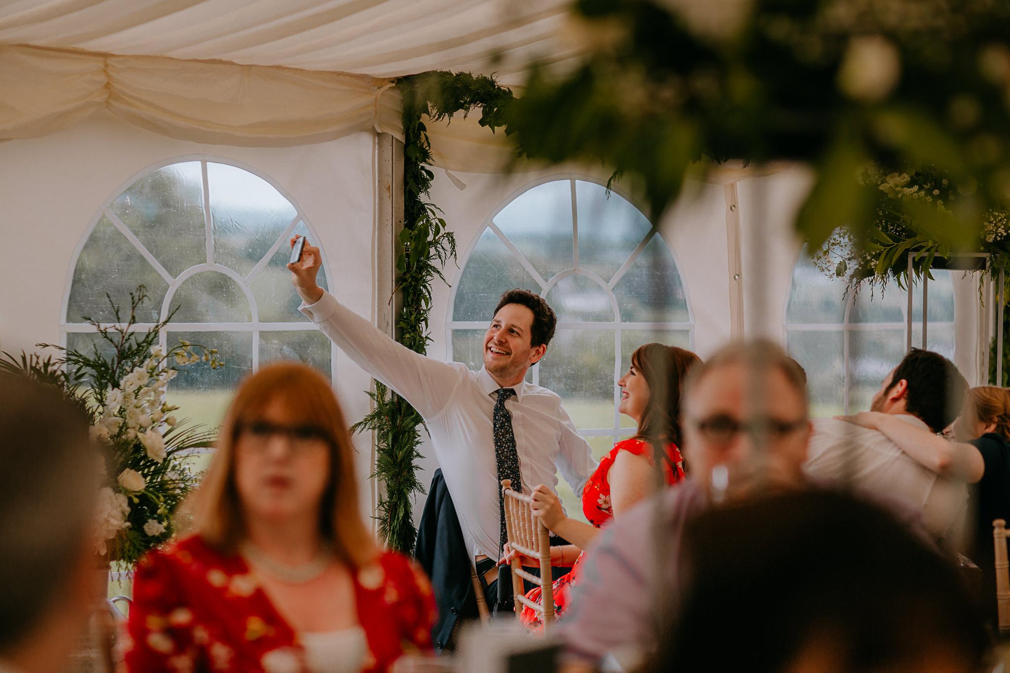 guest taking selfie at wedding recepetion