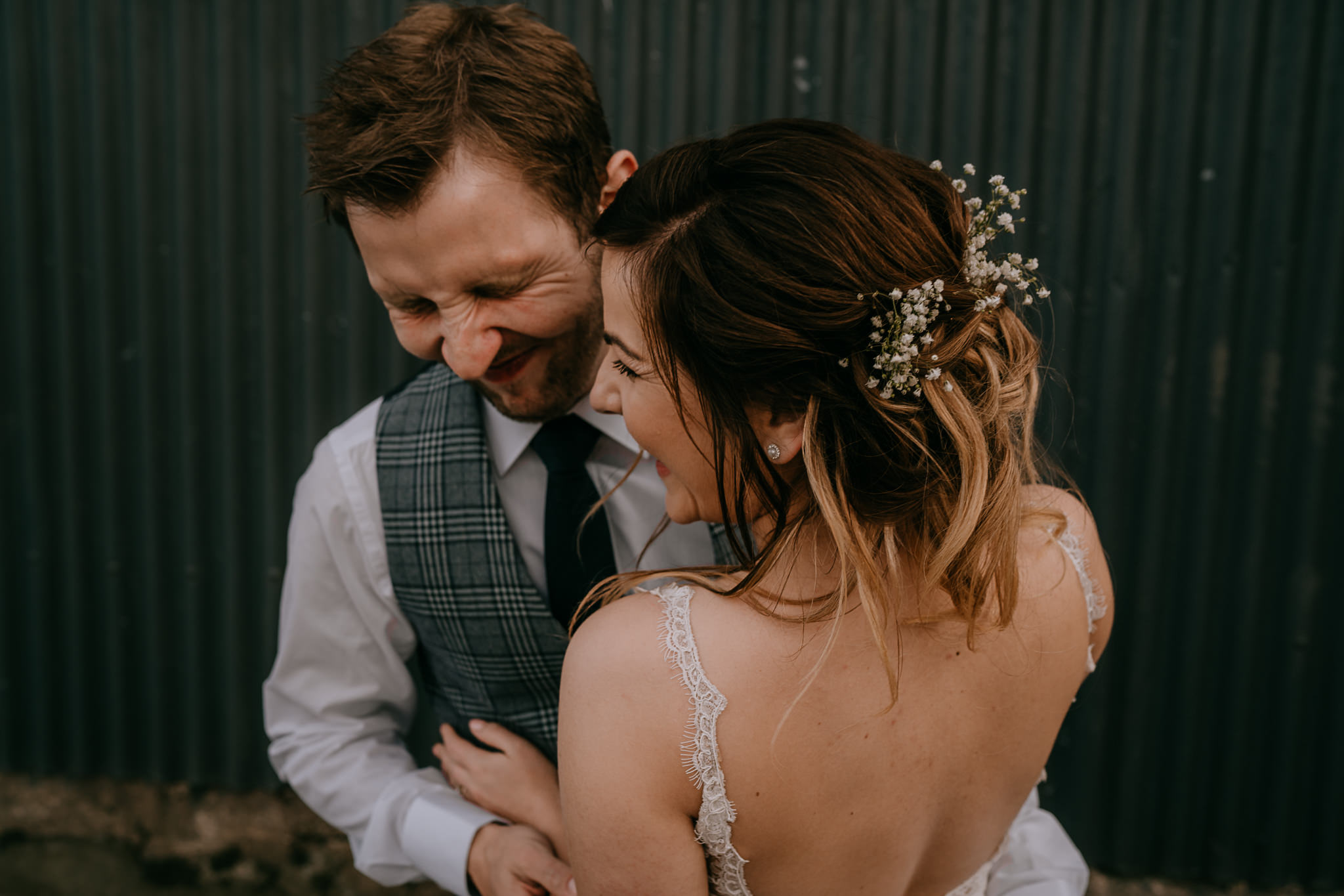 happy couple laughing bride and groom portraits barn wedding