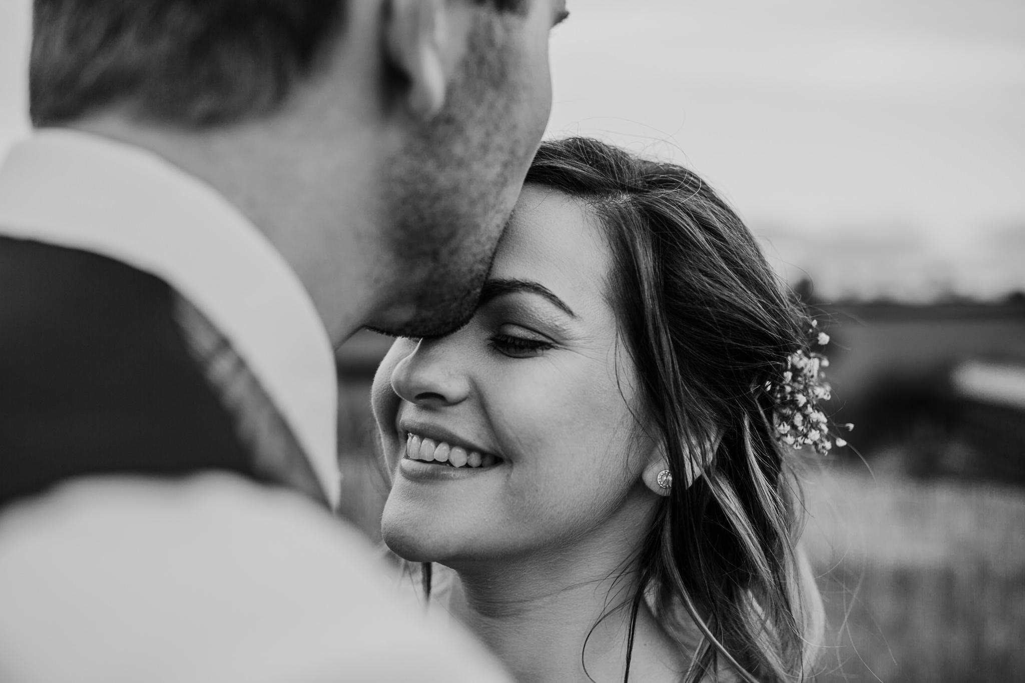 forehead kisses bride and groom wedding portraits