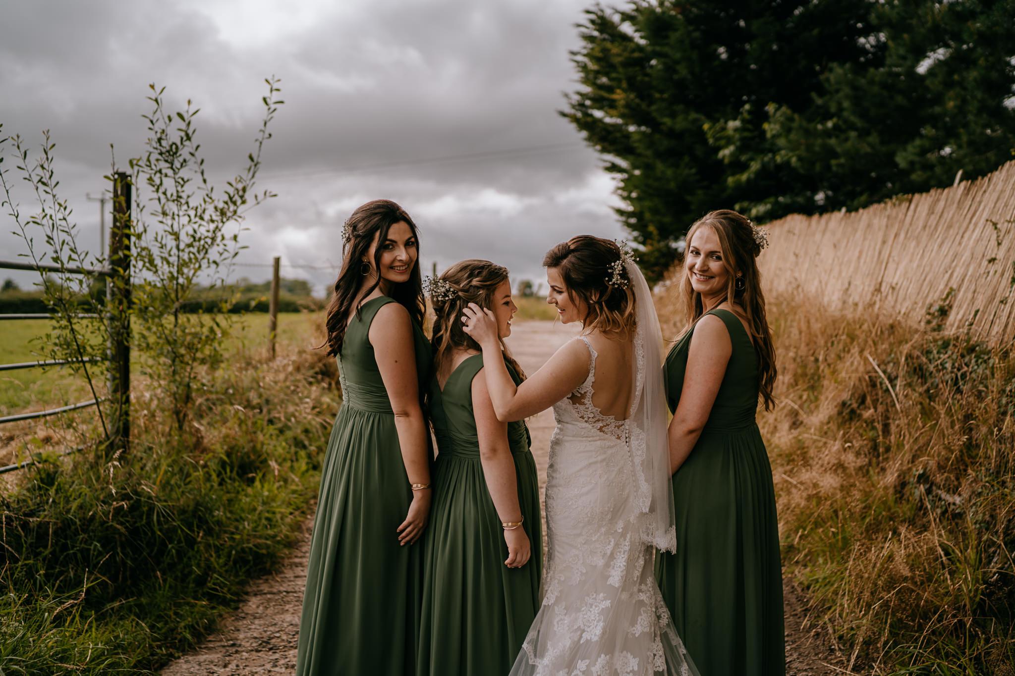 bride and bridesmaids candid moments Northern Ireland wedding photographers