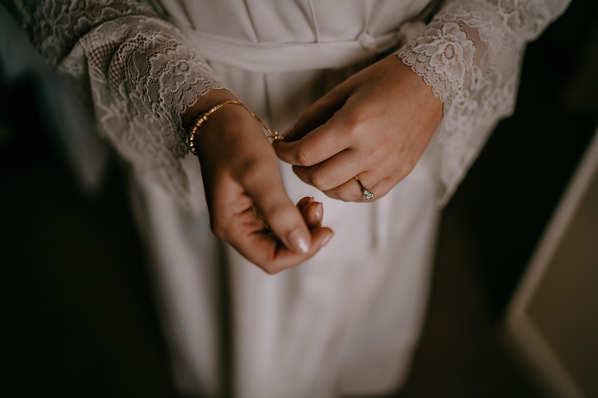 bride nervously plays with jewellery morning of the wedding