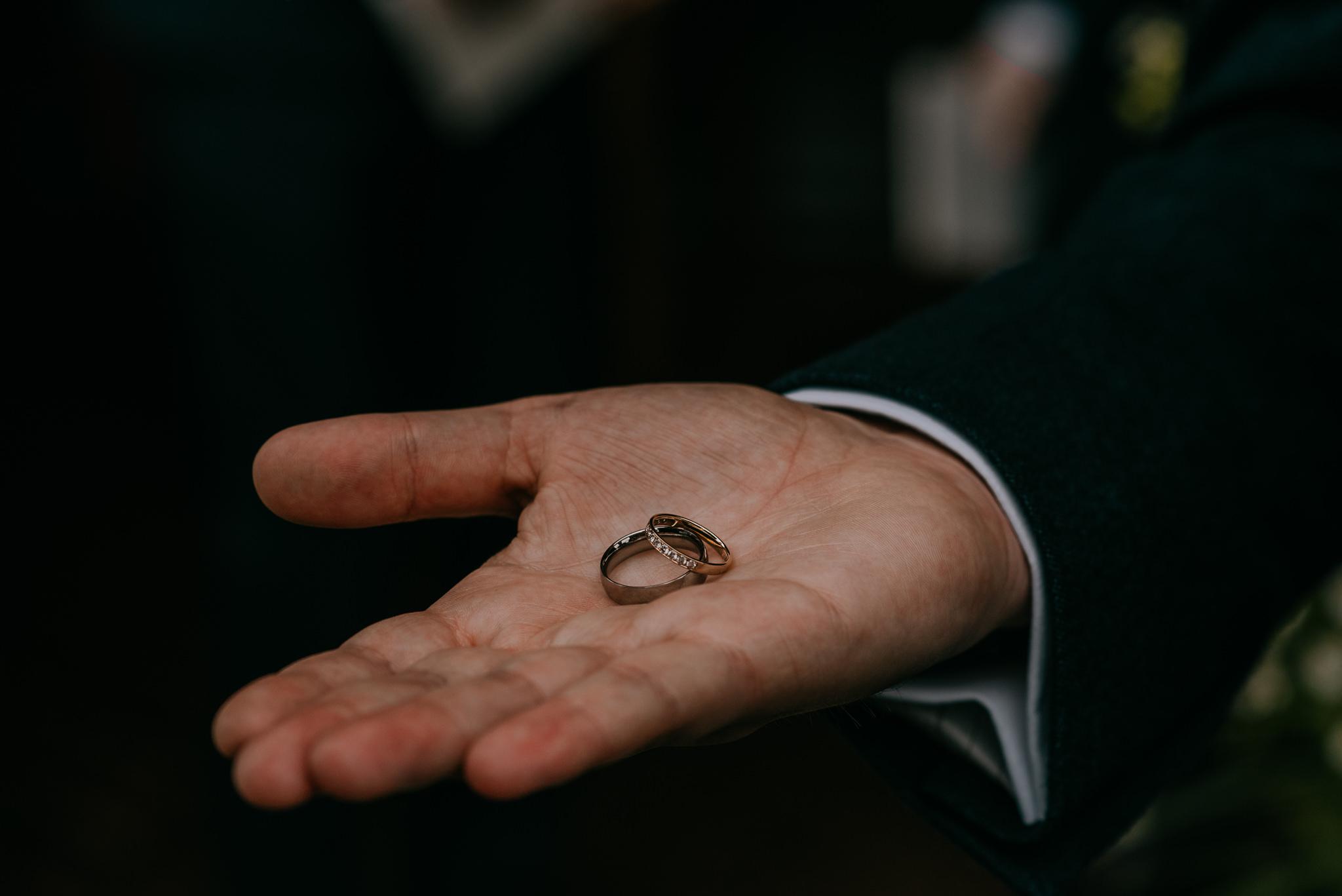 groom holding wedding rings in palm Northern Ireland Wedding Photographers