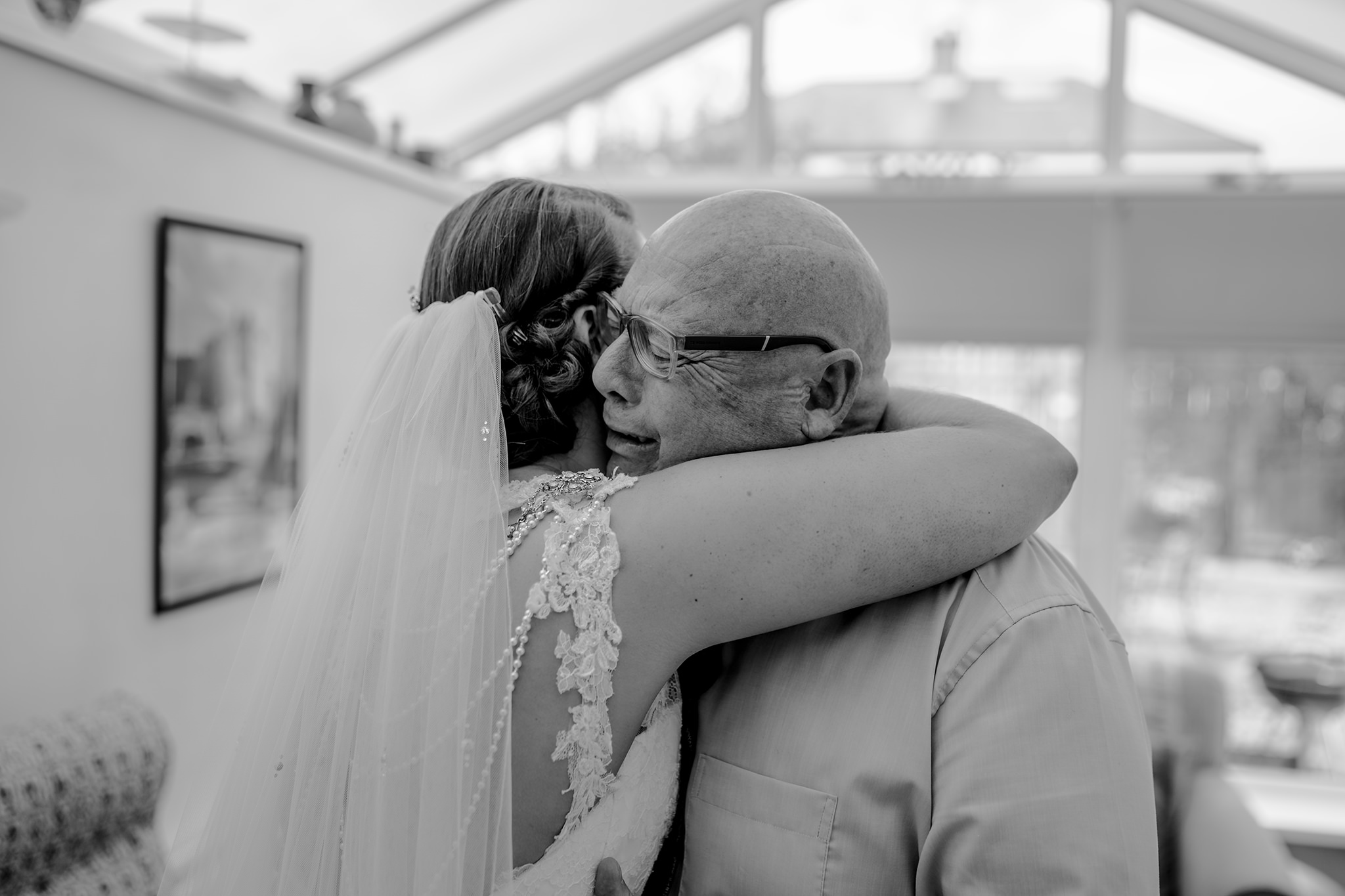 Father of bride hugs first look emotional