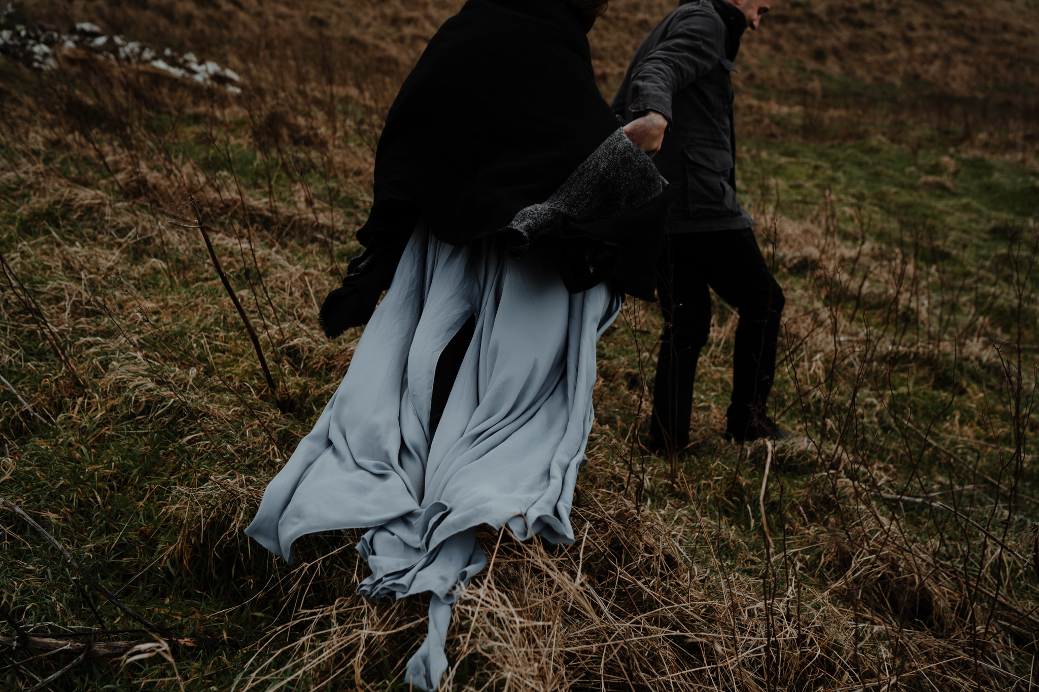 wanderlust rustic elopement northern ireland wind swept dress kinbane castle